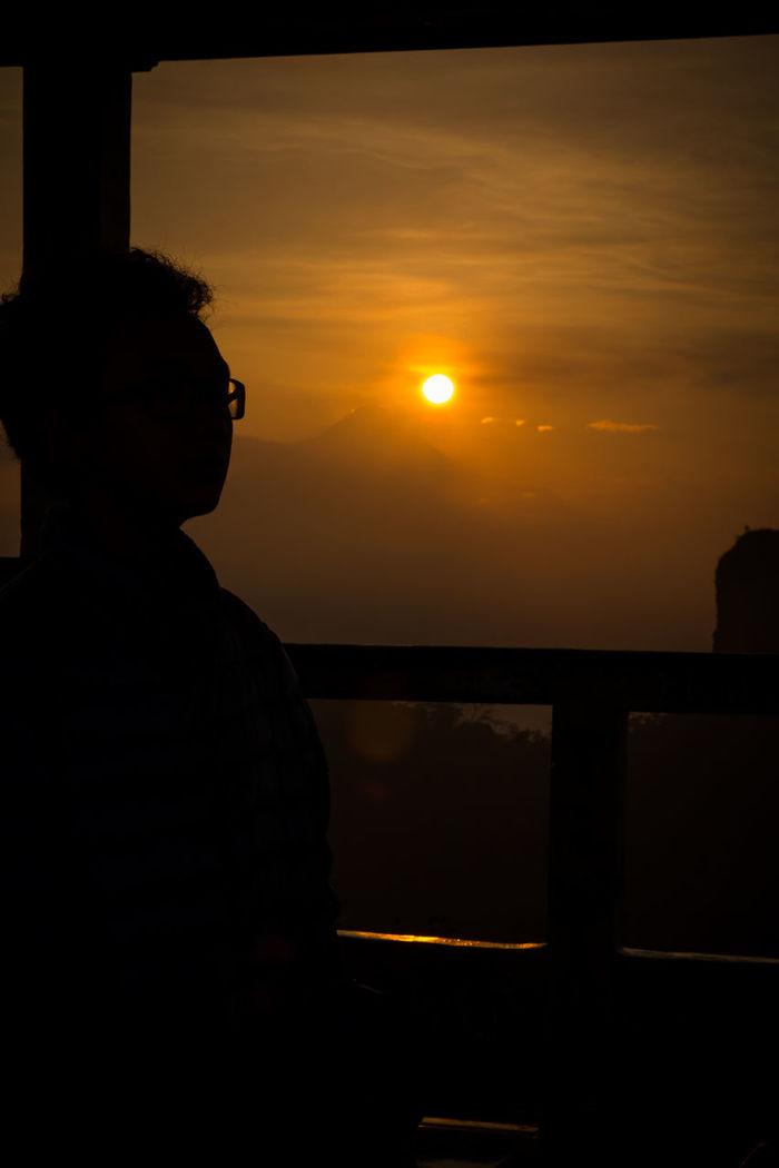Sunrise di Puncak Suralaya, Magelang, Yogyakarta #ExploreJogjakarta #JalanJalan #Jogja #Jogjakarta #PuncakSuralaya #Siluet #Sunrise #travel #travelling #Yogyakarta Beauty In Nature Cloud - Sky Mountain Nature Orange Color Outdoors Silhouette Sky Sun Sunbeam