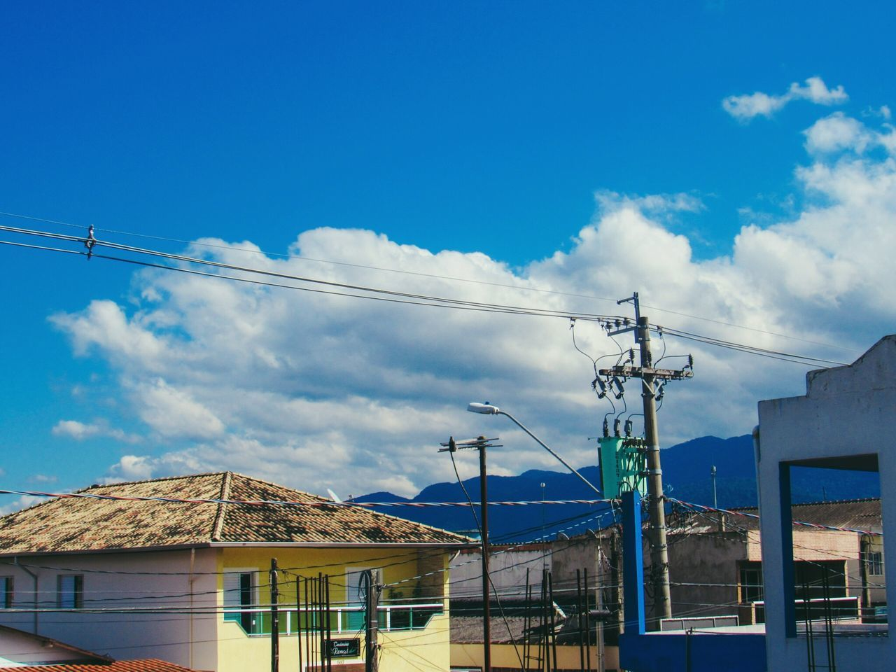 cable, power line, connection, blue, day, outdoors, no people, sky, power supply, electricity pylon, electricity, low angle view, architecture, technology, building exterior, nature