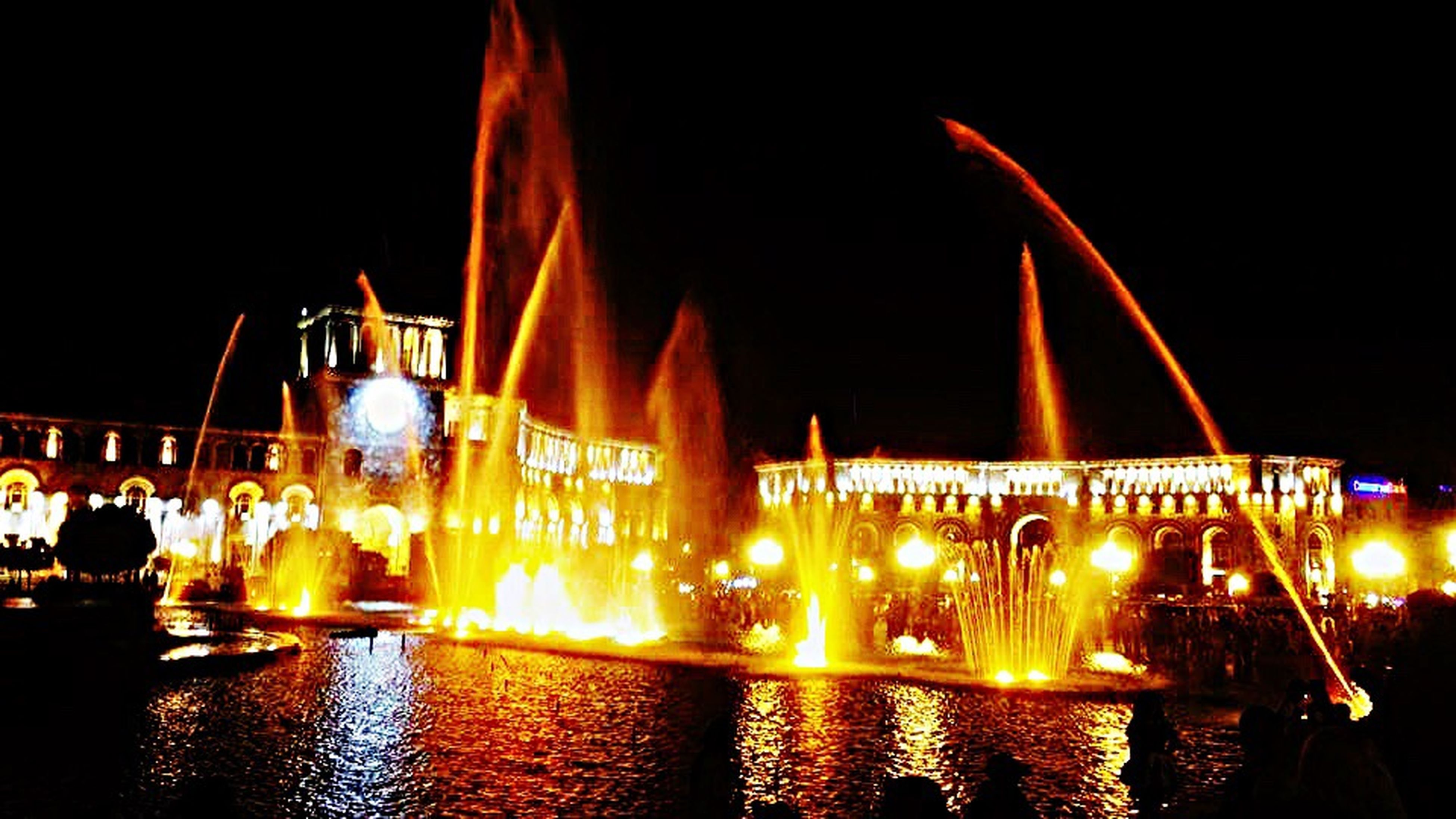night, illuminated, built structure, building exterior, architecture, water, flame, outdoors, no people, city, sky