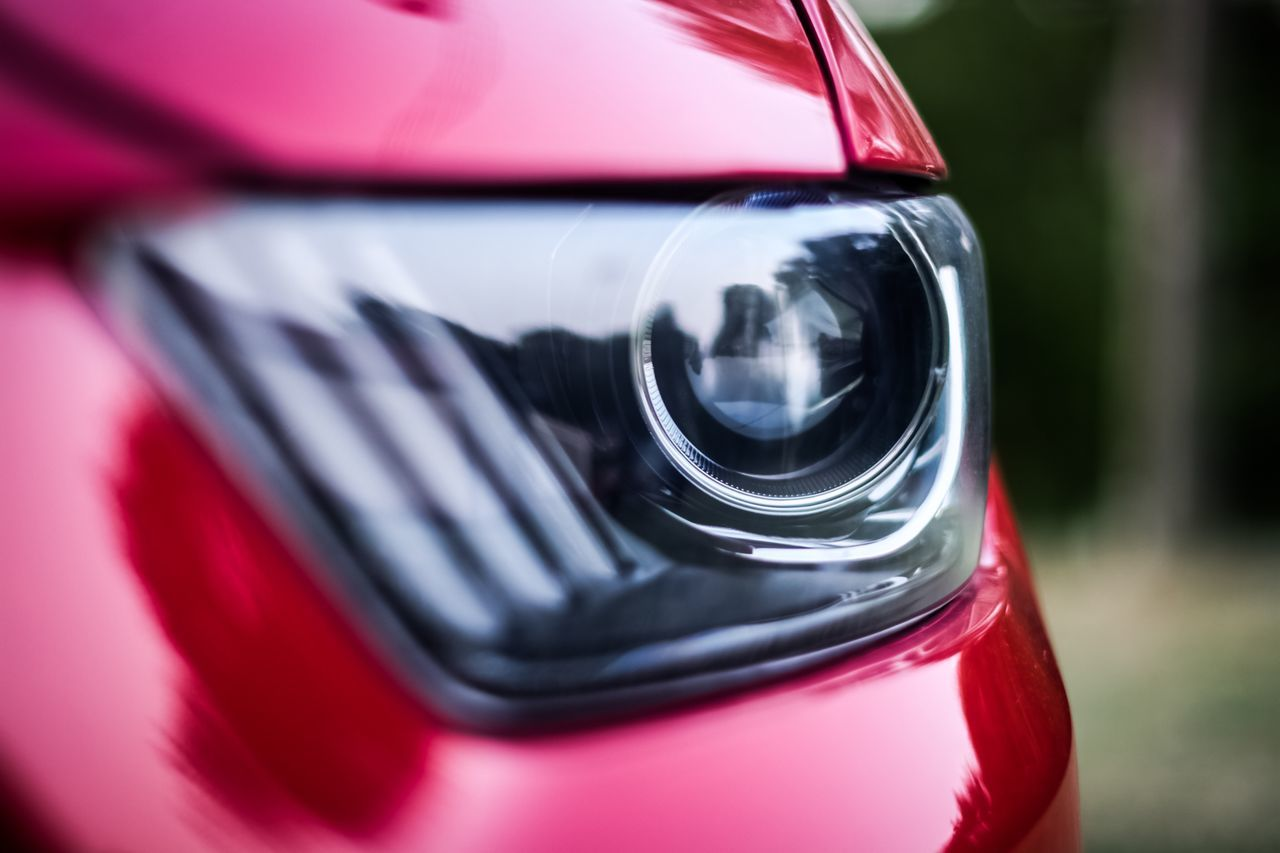 Cropped Image Of Red Car Headlight
