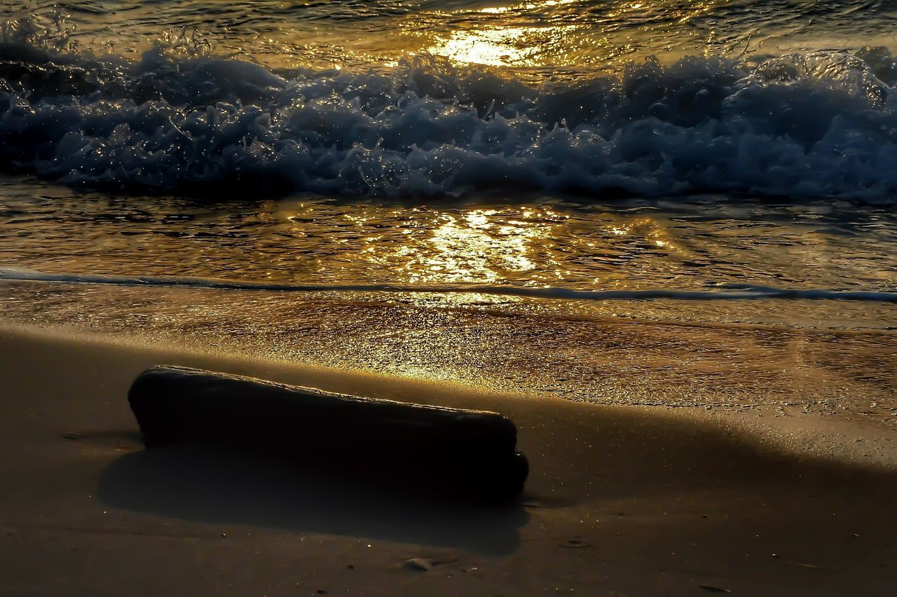 sunset Beach Water Sea Reflection Backgrounds Nature Sunset Outdoors Sunlight Wave Beauty In Nature Close-up No People Scenics