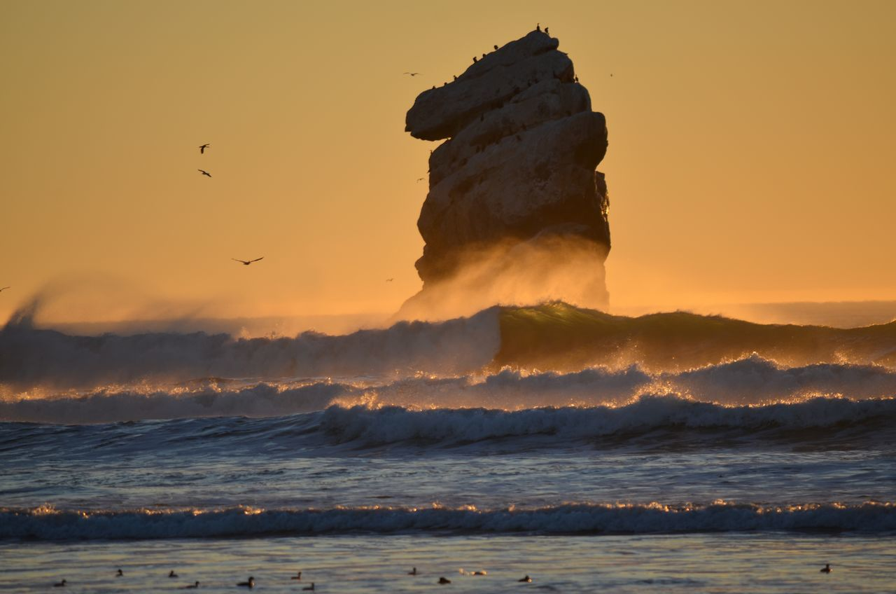 SCENIC VIEW OF Rock At Morro Bay Beach