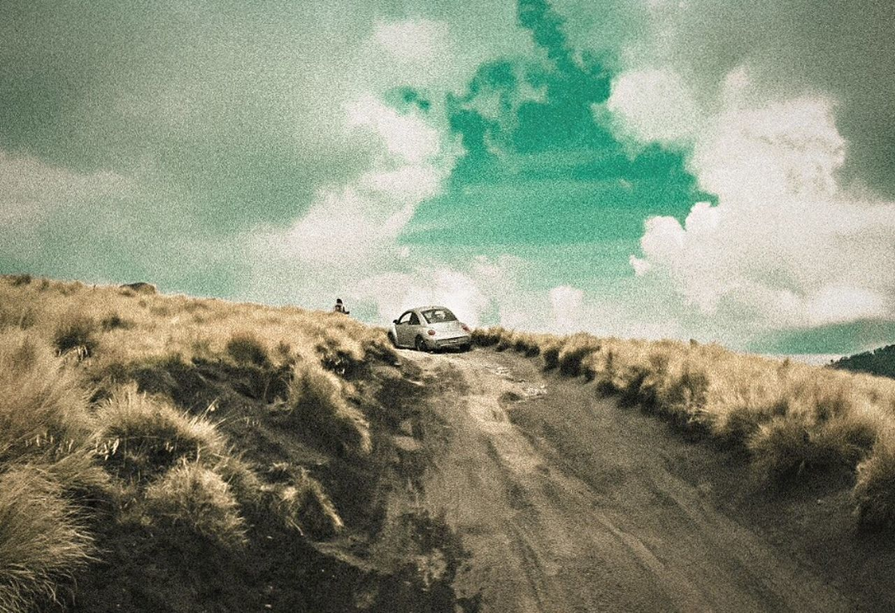 transportation, off-road vehicle, land vehicle, mode of transport, adventure, car, sky, cloud - sky, motorcycle, day, 4x4, outdoors, nature, motocross, grass, no people, motorsport, landscape, extreme sports, sand dune