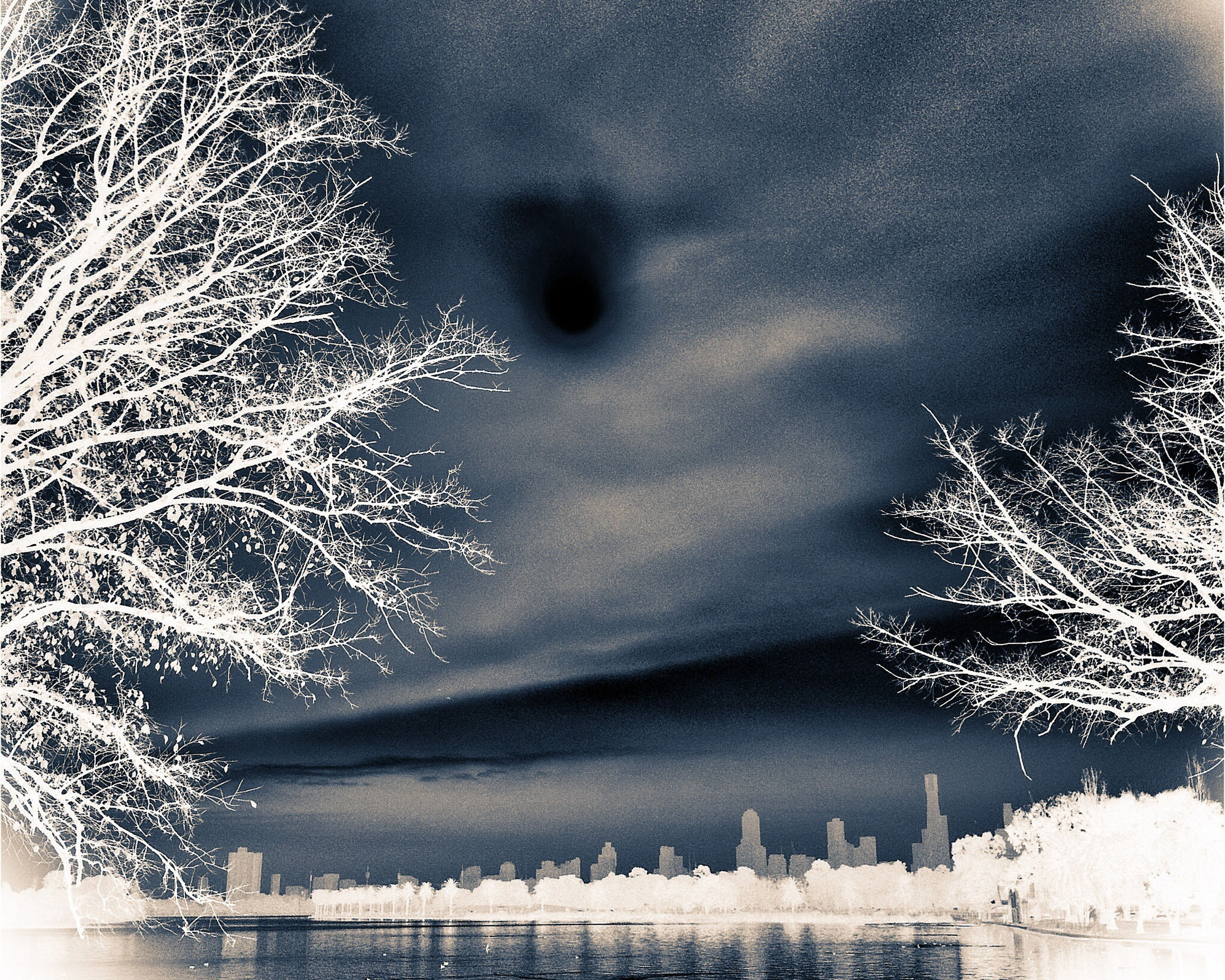 night, water, bare tree, illuminated, tree, sky, built structure, low angle view, building exterior, architecture, branch, waterfront, nature, weather, long exposure, motion, outdoors, reflection, no people, city