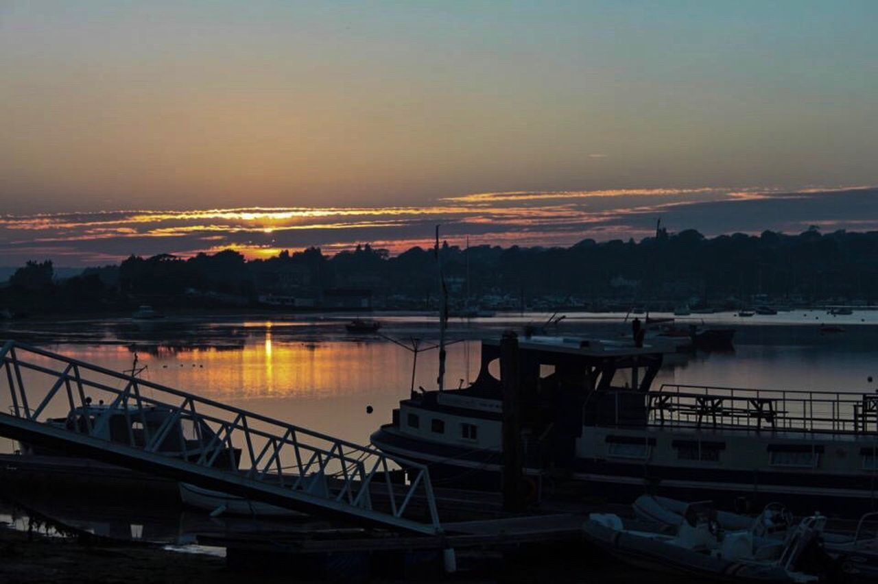 sunset, nautical vessel, water, transportation, boat, sky, mode of transport, scenics, moored, nature, no people, outdoors, river, harbor, mountain, beauty in nature, tranquility, tranquil scene, architecture, built structure, tree, day