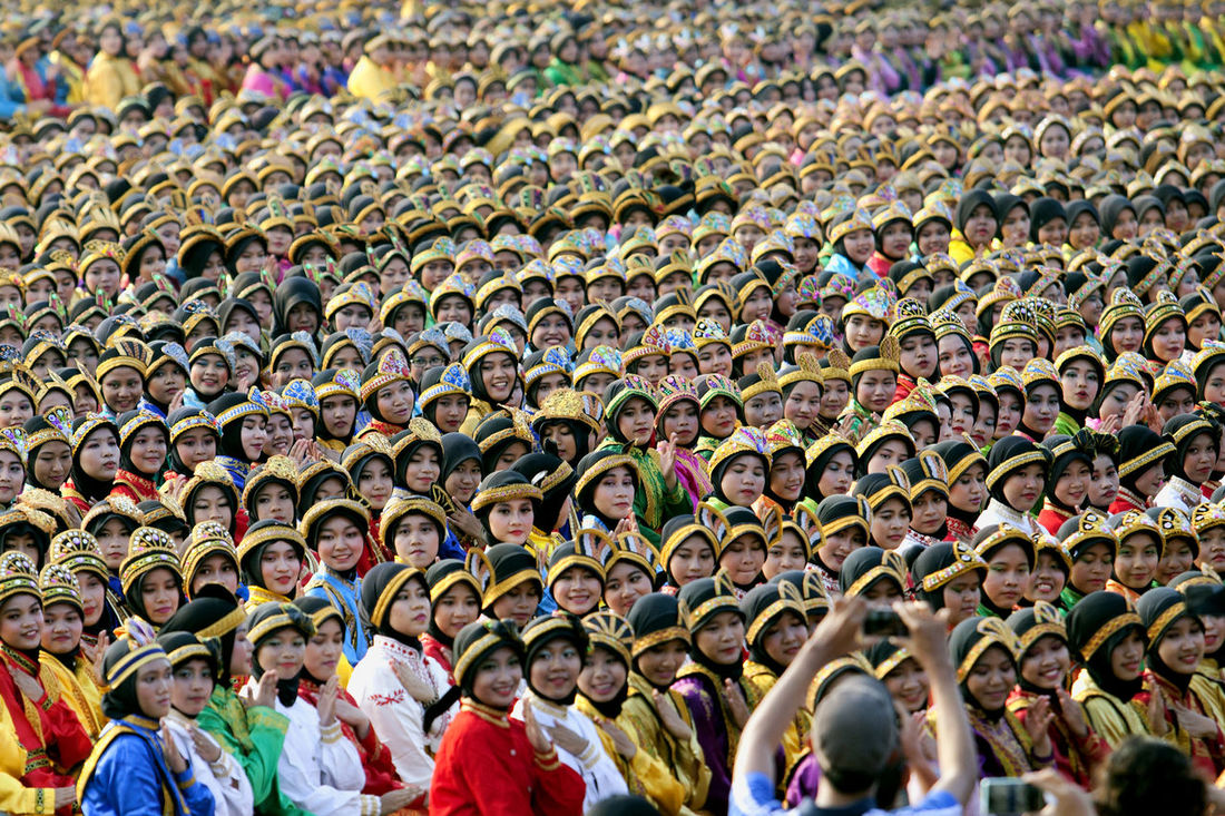 Mass Saman Dance from Aceh Indonesia Aceh Celebration Crowd Culture Culture And Tradition Festival FOLkdance Folklore Horizontal Large Group Of People Outdoors People Saman Dance Traditional