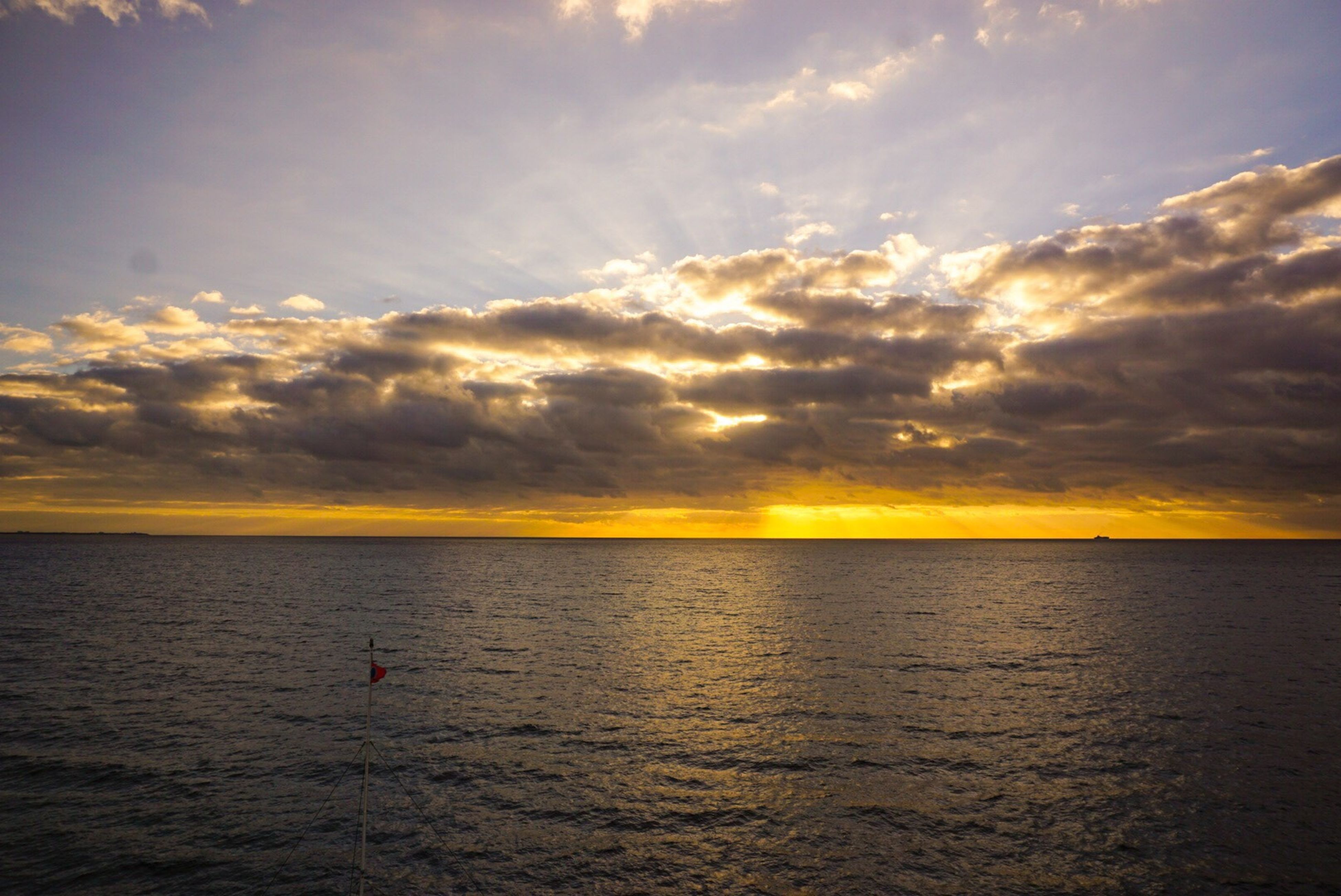 sea, water, sunset, horizon over water, sky, scenics, tranquil scene, beauty in nature, tranquility, waterfront, cloud - sky, idyllic, cloud, nature, rippled, cloudy, orange color, reflection, seascape, sun