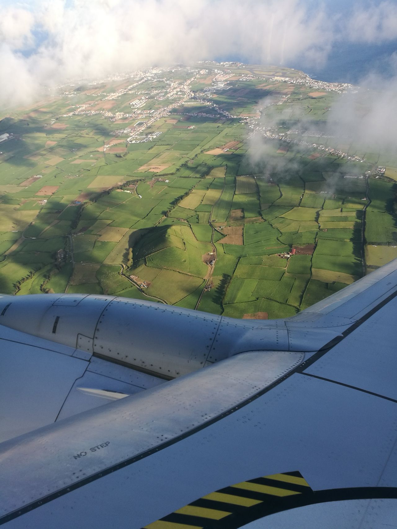 Agriculture Farm Aerial View Field Rural Scene Landscape Airplane Outdoors Sky Flying Scenics Nature Azores Travel Window Plane Aerial Shot Horizon Over Water Aerial Photography Cloud And Sky Aircraft Wing Transportation Field Farm Agriculture