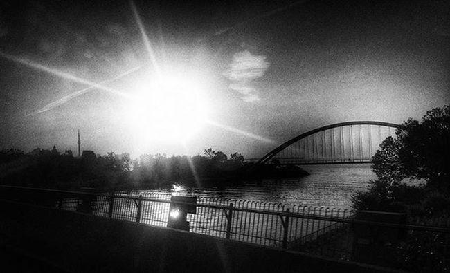 Toronto sunrise. Or impending doom. Toronto Sunrise Blackandwhite Blackandwhitephotography Cntower Humberriver Bridge