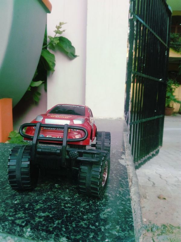 Toy Toy Car Close-up Red Green Colours Orange Yellow Gate SSClickPics SSClicks Big Wheels Wall Boundary Wall Best Shot Evening Light Mobile Photography