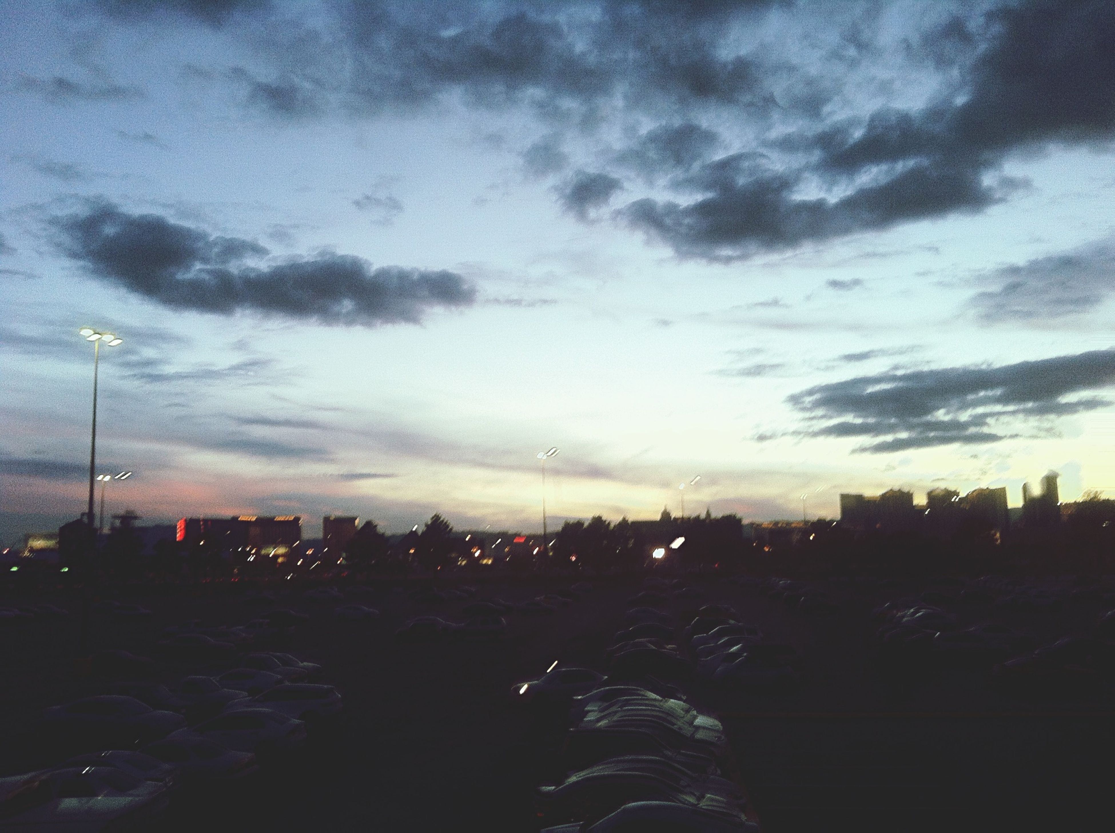 sky, building exterior, cloud - sky, silhouette, sunset, built structure, city, architecture, cityscape, cloudy, dusk, cloud, outdoors, residential district, nature, dark, residential building, dramatic sky, landscape, residential structure