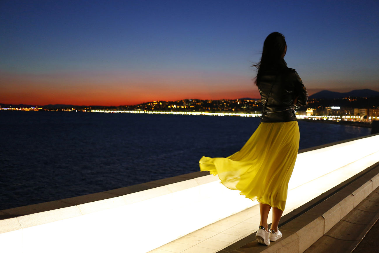 Azul Beach Beauty In Nature Nature Night Nightphotography One Person One Woman Only Only Women Outdoors People Rear View Sky Sunset Traveling Water Yellow Dress Young Women