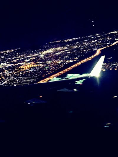Flying High Night Illuminated City Water Outdoors Sea Sky No People Nature Airplane Cityscape Beauty In Nature Architecture Airplane Wing