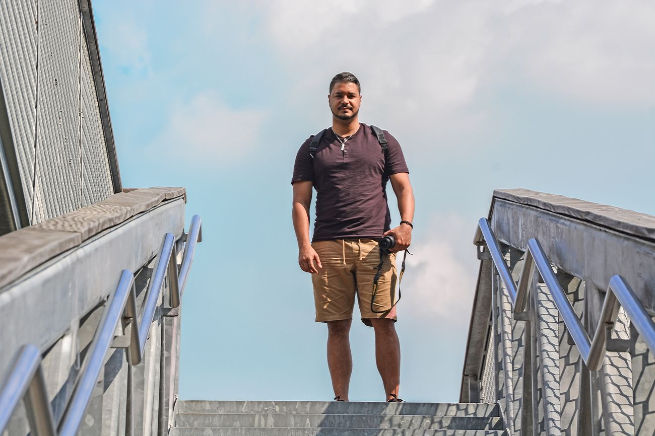 Real People One Person Casual Clothing Leisure Activity Outdoors Front View Railing Sky Lifestyles Standing Young Adult Mid Adult Men Mid Adult Young Men Day Full Length Cloud - Sky Low Angle View Architecture Portrait