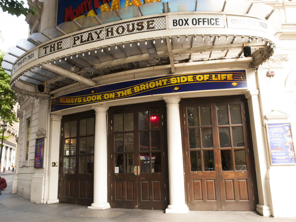 The Playhouse Theatre is a West End theatre in the City of Westminster, located in Northumberland Avenue, near Trafalgar Square. The Theatre was built by F. H. Fowler and Hill with a seating capacity of 1,200. It was rebuilt in 1907 and still retains its original substage machinery.In 1951 it was taken over by the BBC as a recording studio for live performances. The Goon Show and the radio versions of Hancock's Half Hour and Steptoe and Son were recorded here, although at least the first two shows were also recorded at other venues during their runs. The stage also hosted live performances by KISS, Queen, Led Zeppelin, The Who, The Beatles and The Rolling Stones. On 3 April 1967, a live Pink Floyd concert was broadcast from the theatre. F. H. Fowler And Hill Pink Floyd The Beatles Architecture Book Office Building Exterior Built Structure Closed Communication Day Entrance Entryway Exterior Façade History Outdoors Playhouse Theatre Text The Rolling Stones. Vivid International West End Theatre