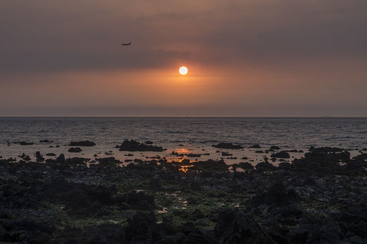 sunset in the coast of Jeju Island, South Korea JEJU ISLAND  Airplaine Beauty In Nature Clear Sky Day Horizon Over Water Idyllic Moon Nature No People Outdoors Scenics Sea Silhouette Sky Sun Sunset Tranquil Scene Tranquility Water