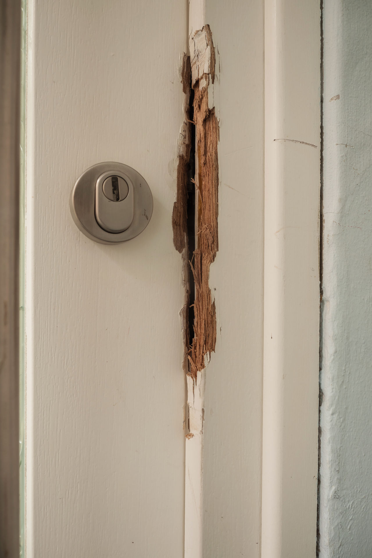 Damaged door frame after a burglary Breaking Security Architecture Broken Built Structure Burglary Close-up Damaged Day Door Housebraking Indoors  Lock No People Raid Repair White Color Wooden