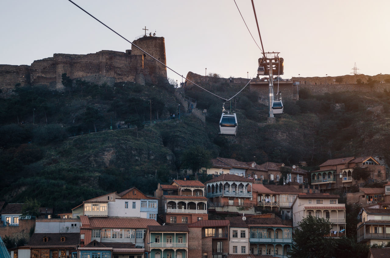 Tbilisi Old Town and Narikala Fortress on the background of the cableway at sunset. Landmark of Georgia Ancient Ancient Architecture Architecture Architecture Architecture_collection Building Exterior Cable Car City Cityscape Fortress Funicular Georgia Georgian Architecture Houses Outdoors Overhead Cable Car Rock Tbilisi Town