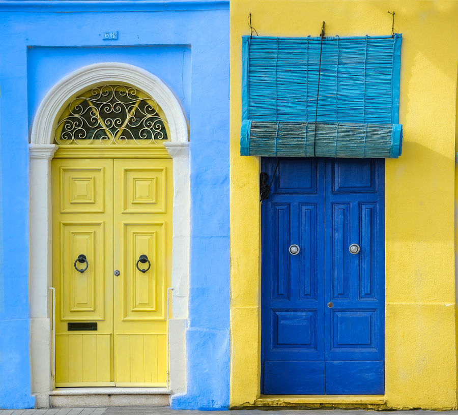 Architecture Blue Bohemian Building Exterior Built Structure Closed Day Dominant Color Door Doors Fishing Village Malta Marsaxlokk No People Old Outdoors Protection Safety Selective Color Tourism Travelling Villa Vintage Yellow Yellow Color