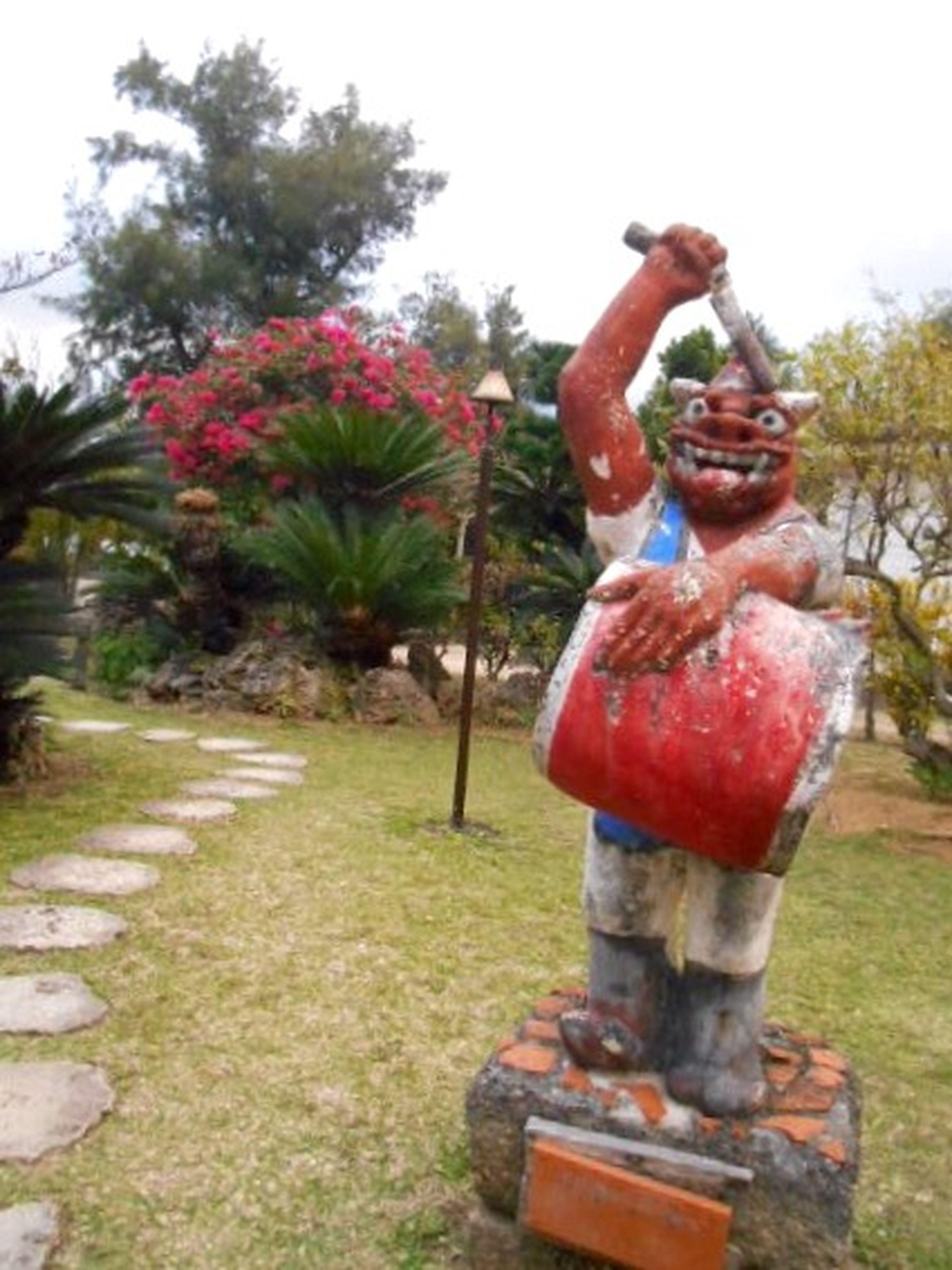 statue, sculpture, human representation, art, art and craft, tree, creativity, park - man made space, animal representation, religion, sky, day, buddha, outdoors, full length