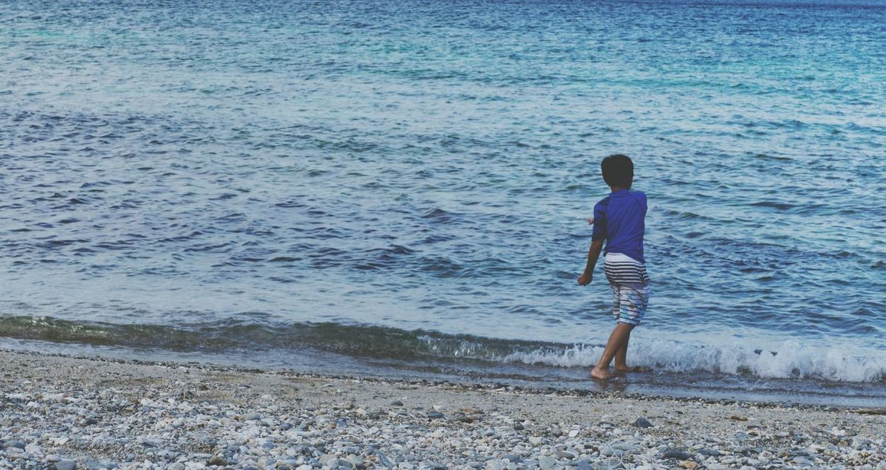 Full Length Beach Child Sand One Boy Only One Person Childhood Water Rear View Children Only Sea Lifestyles Real People Leisure Activity Outdoors Males  Standing Vacations Day Eyeem Philippines XperiaZ3 Mobilephotography Xperiaphotography