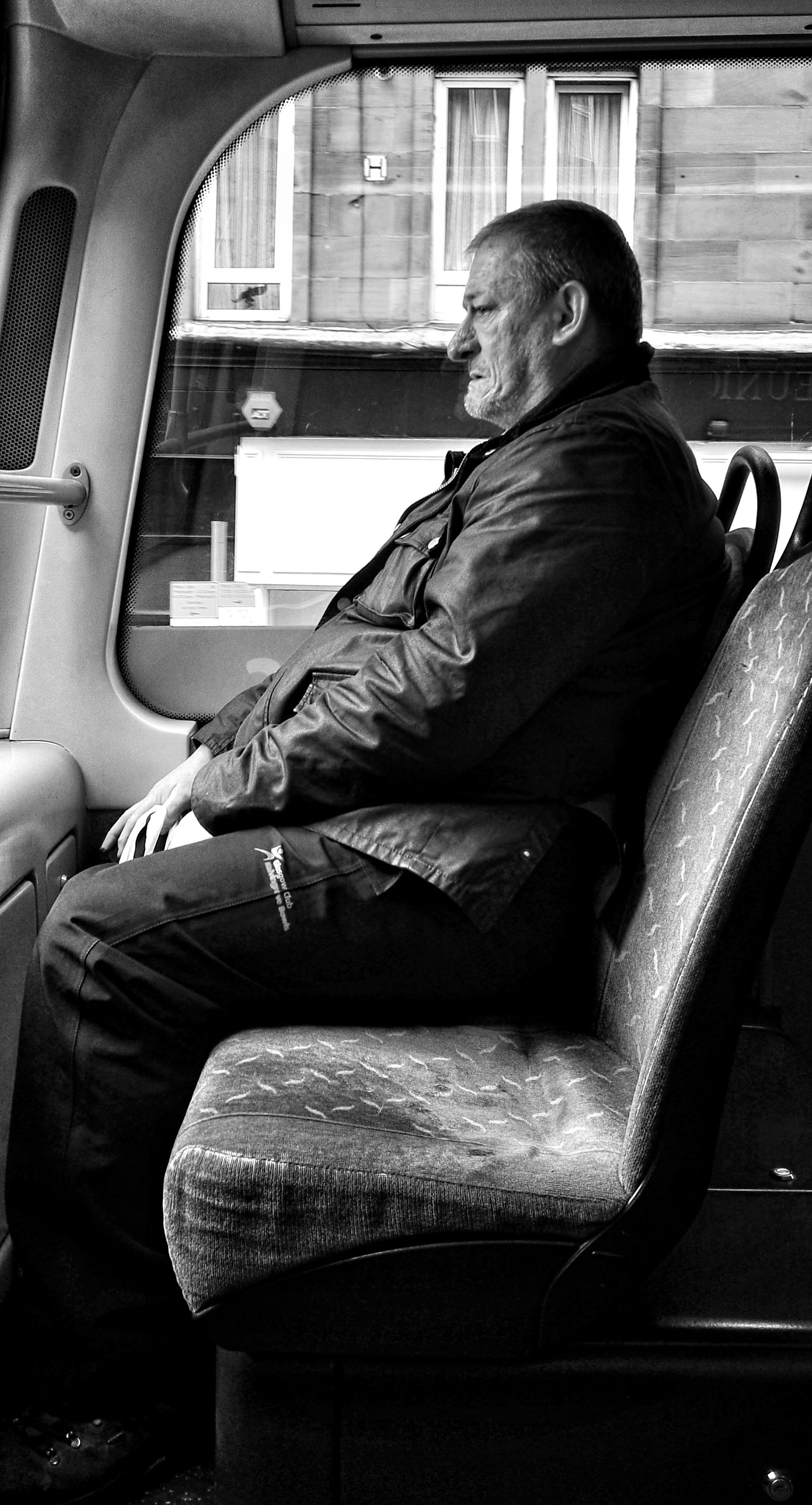 sitting, one person, real people, transportation, public transportation, casual clothing, side view, lifestyles, leisure activity, young adult, vehicle seat, full length, legs crossed at knee, day, relaxation, young women, warm clothing, indoors, adult, people