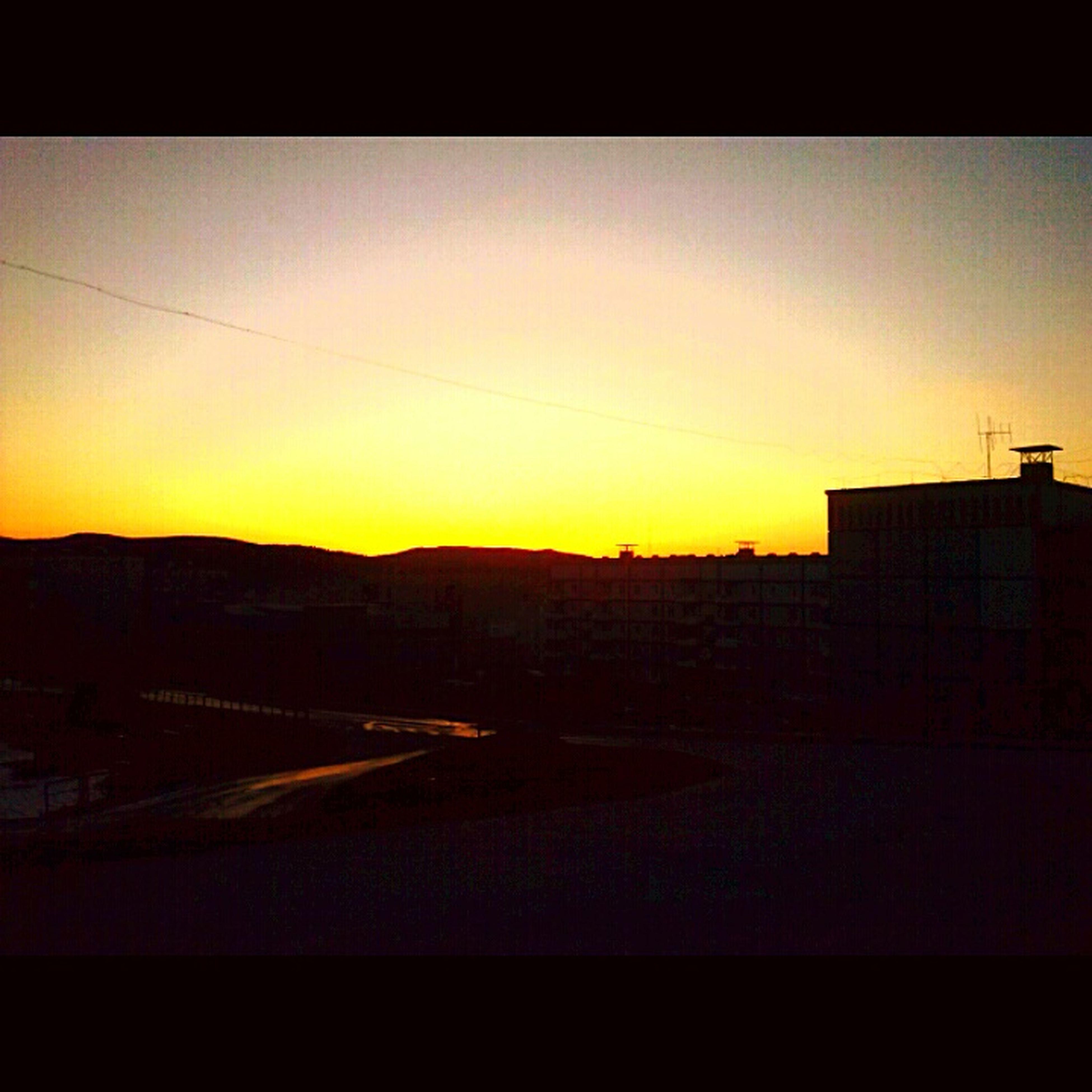 sunset, transfer print, building exterior, built structure, silhouette, orange color, architecture, sky, copy space, auto post production filter, clear sky, transportation, dusk, house, outdoors, no people, dark, nature, power line, sunlight