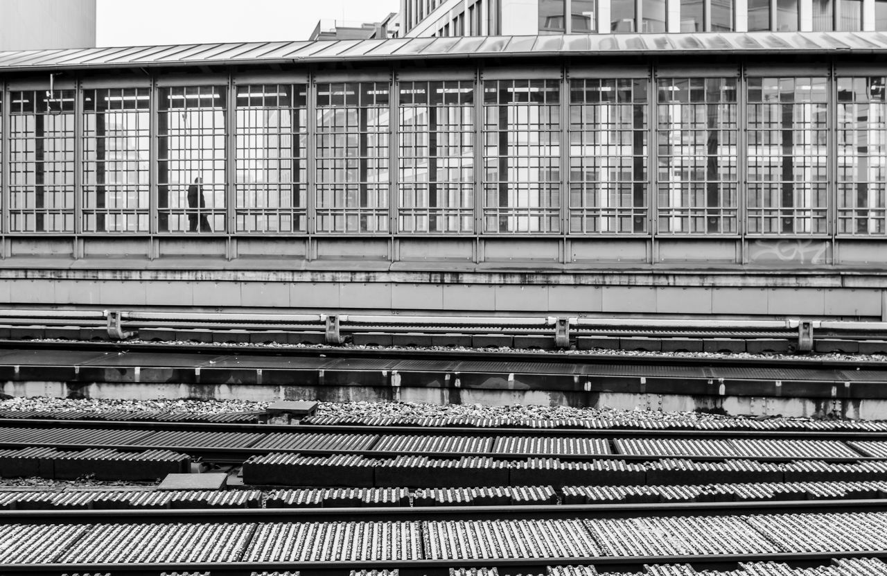 Architecture Black And White Built Structure Day One Person Outdoors Rail Transportation Railroad Station Railroad Station Platform Railroad Track Schienen Transportation