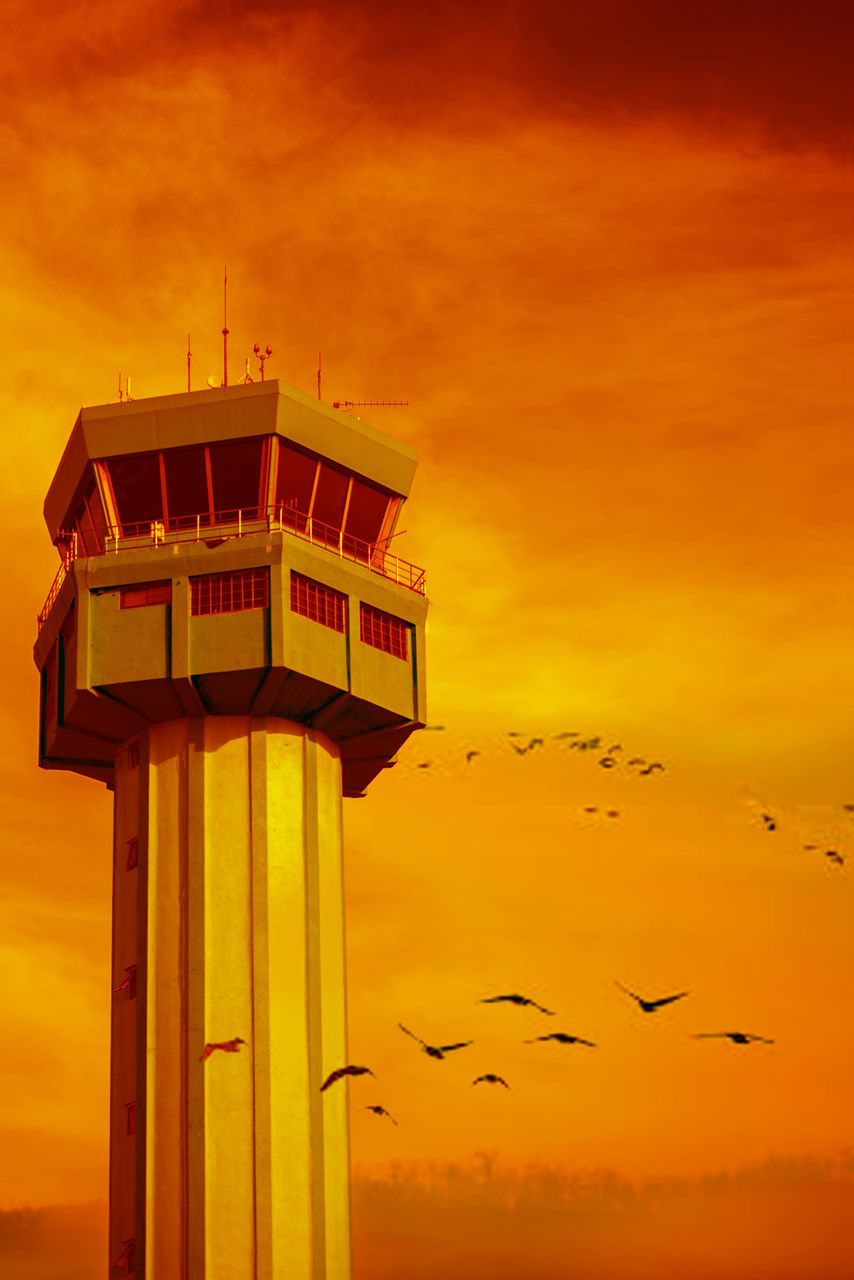 sunset, sky, architecture, orange color, built structure, cloud - sky, building exterior, bird, animal themes, low angle view, outdoors, nature, animals in the wild, architectural column, no people, travel destinations, beauty in nature, flying, day