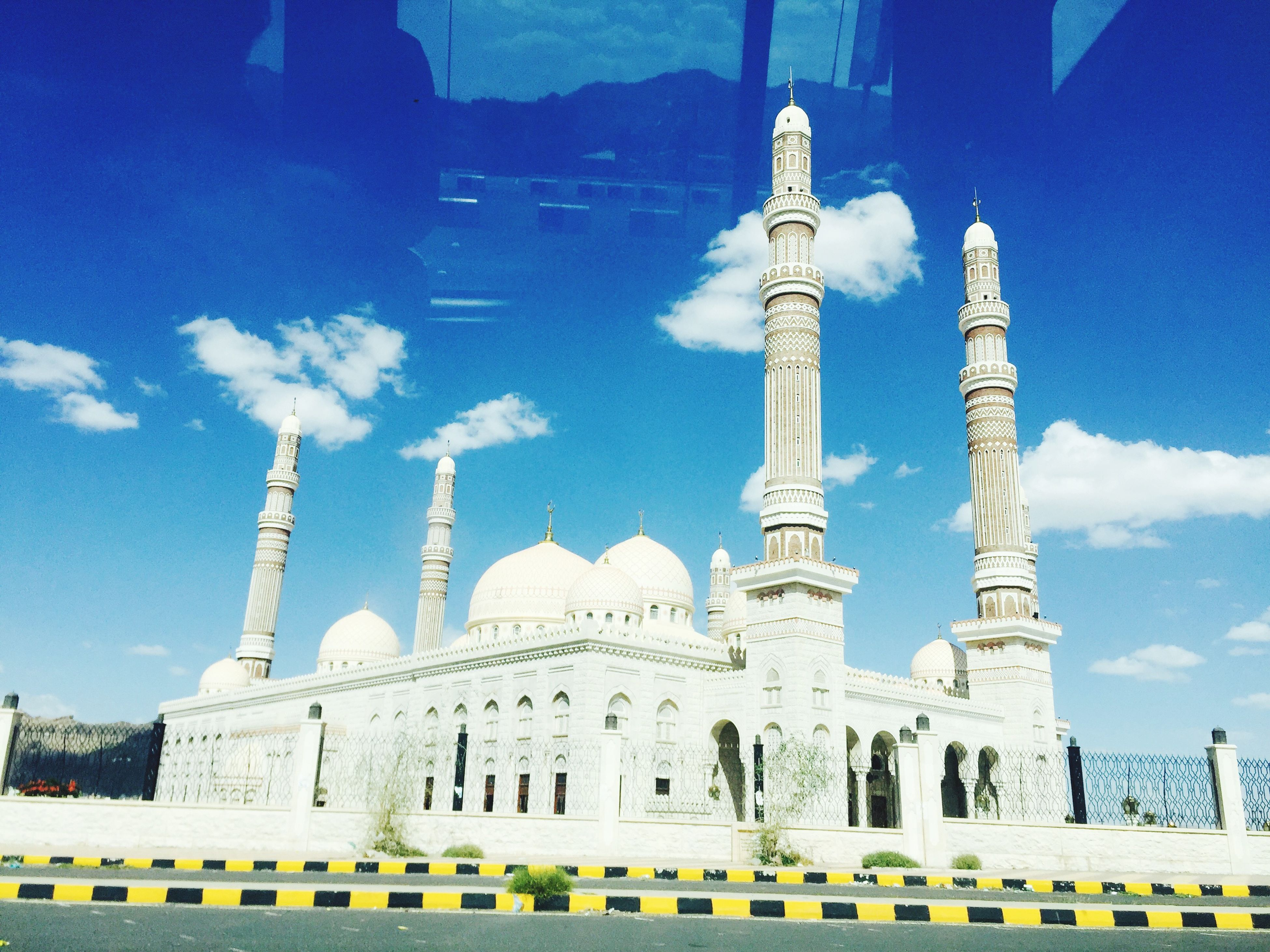 architecture, built structure, famous place, building exterior, travel destinations, international landmark, tourism, blue, travel, capital cities, low angle view, sky, city, history, architectural column, tower, architectural feature, tall - high, mosque, place of worship