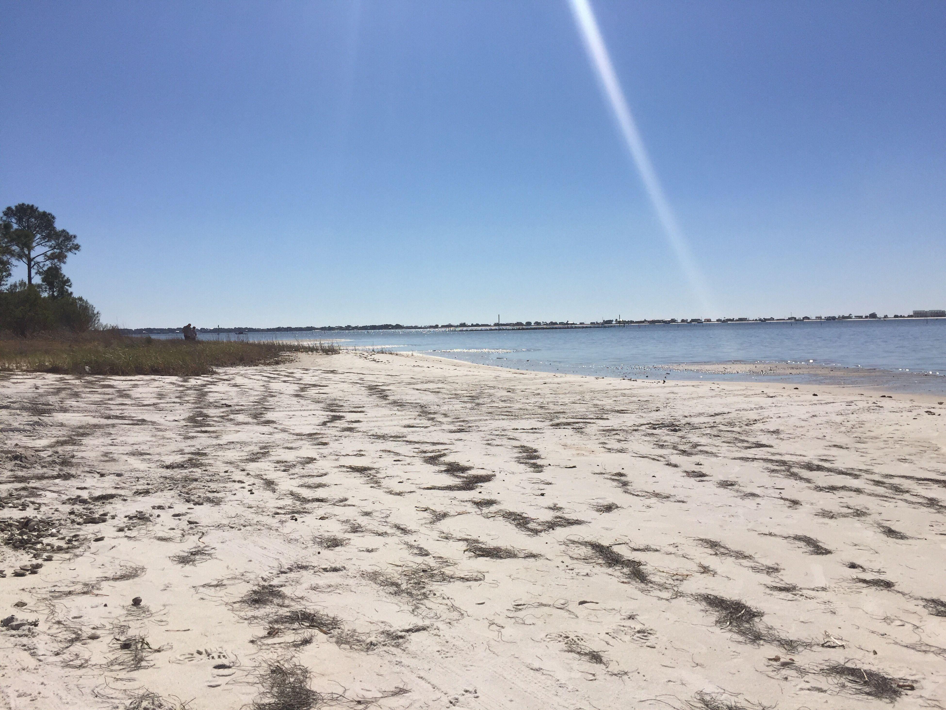 beach, tranquility, tranquil scene, scenics, water, clear sky, blue, sand, beauty in nature, sea, shore, sunlight, nature, sun, sunbeam, horizon over water, copy space, idyllic, sunny, sky