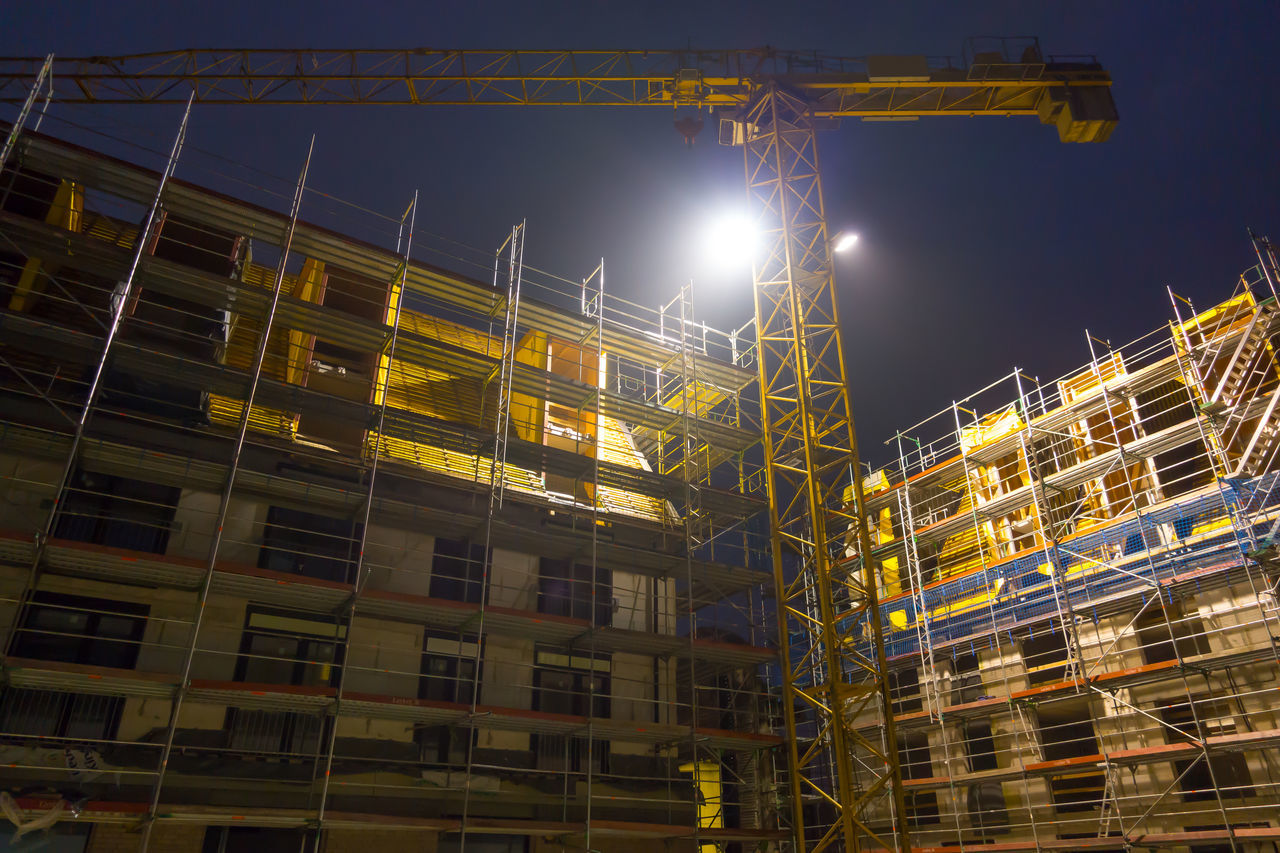 Construction site with crane at night Architecture City Construction Construction Industry Construction Machinery Construction Site Crane Crane - Construction Machinery Illuminated Low Angle View Night No People Outdoors