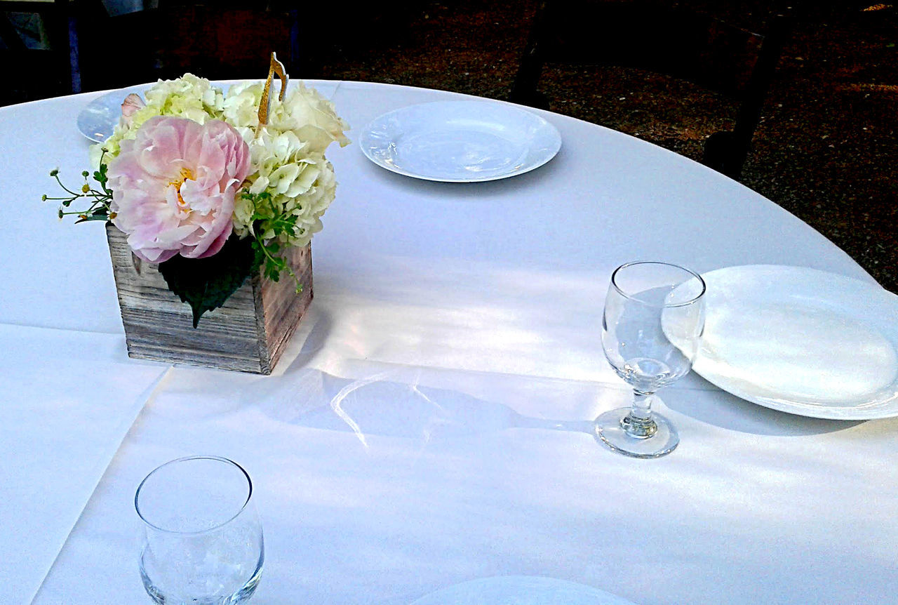 Beautiful roses and flowers in pink and white as a centerpiece on a dining table for a wedding reception. Close-up Day Dinner Drinking Glass Elegant Evening Flower Food Food And Drink Freshness Nature No People Plate Rose - Flower Table White Tablecloth Wineglass