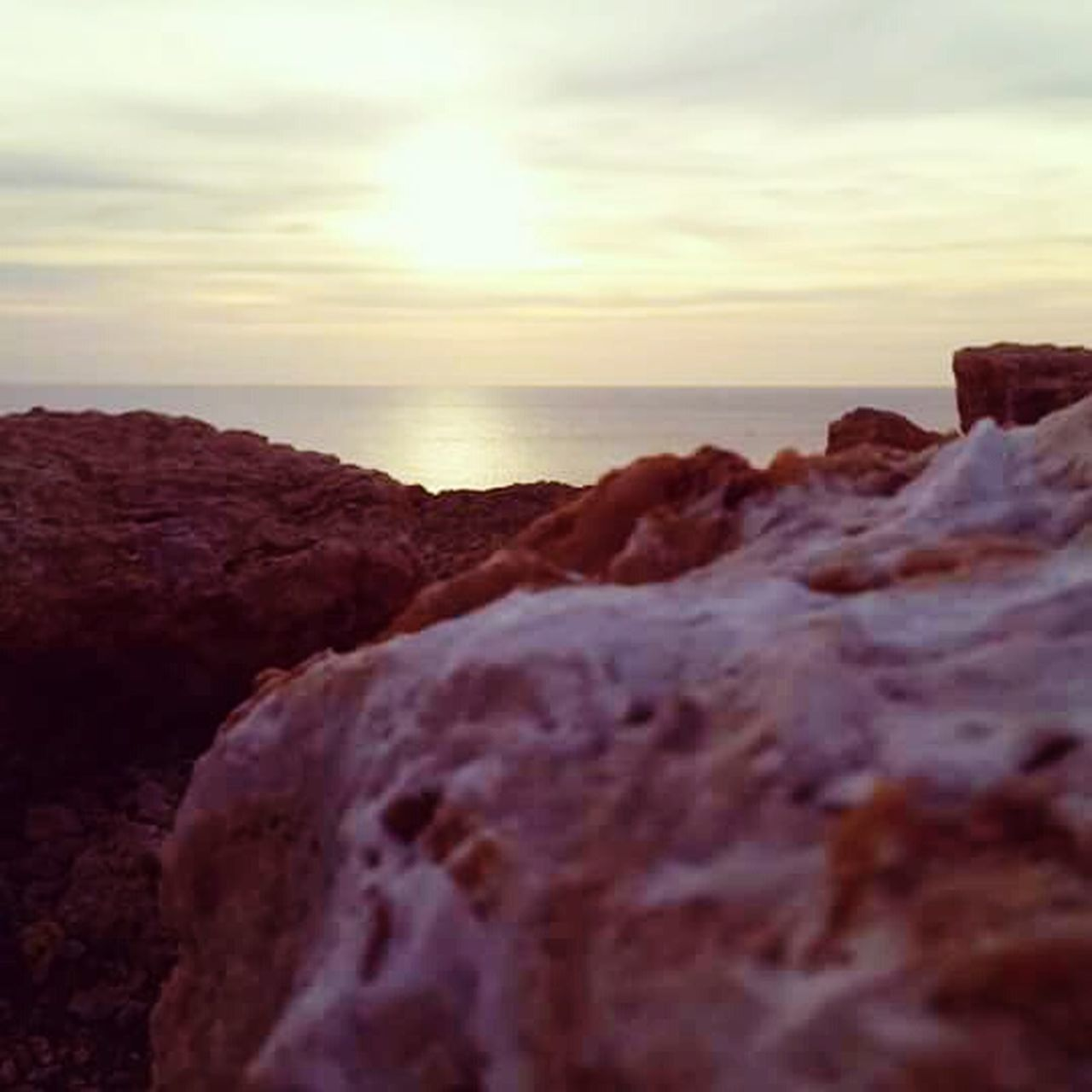 rock - object, sea, nature, scenics, sunset, beauty in nature, rock formation, geology, horizon over water, sky, tranquility, no people, beach, tranquil scene, water, sun, cliff, outdoors, travel destinations, wave, day