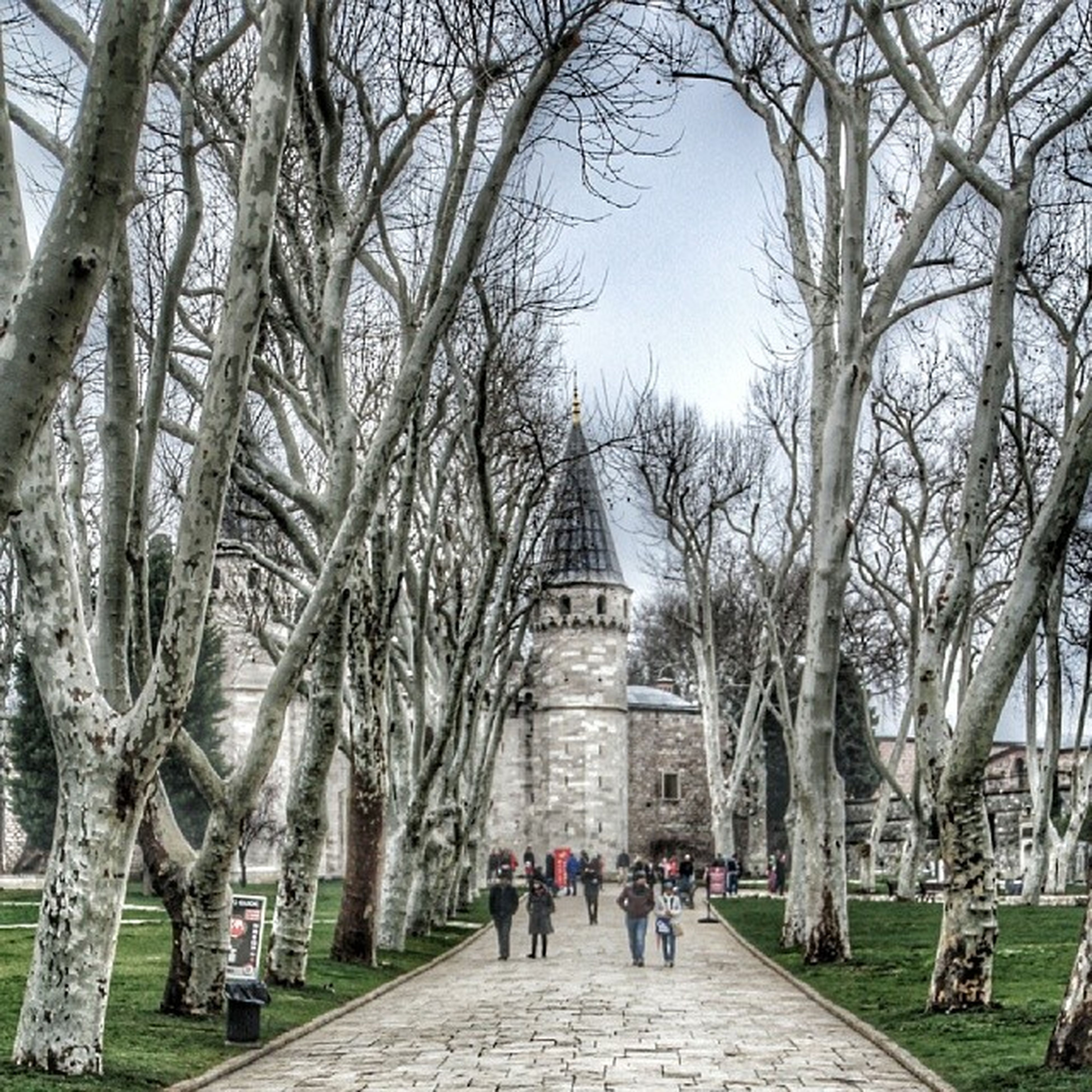 architecture, built structure, building exterior, person, tree, large group of people, men, lifestyles, tourist, the way forward, walking, tourism, leisure activity, famous place, travel destinations, travel, religion, place of worship, history