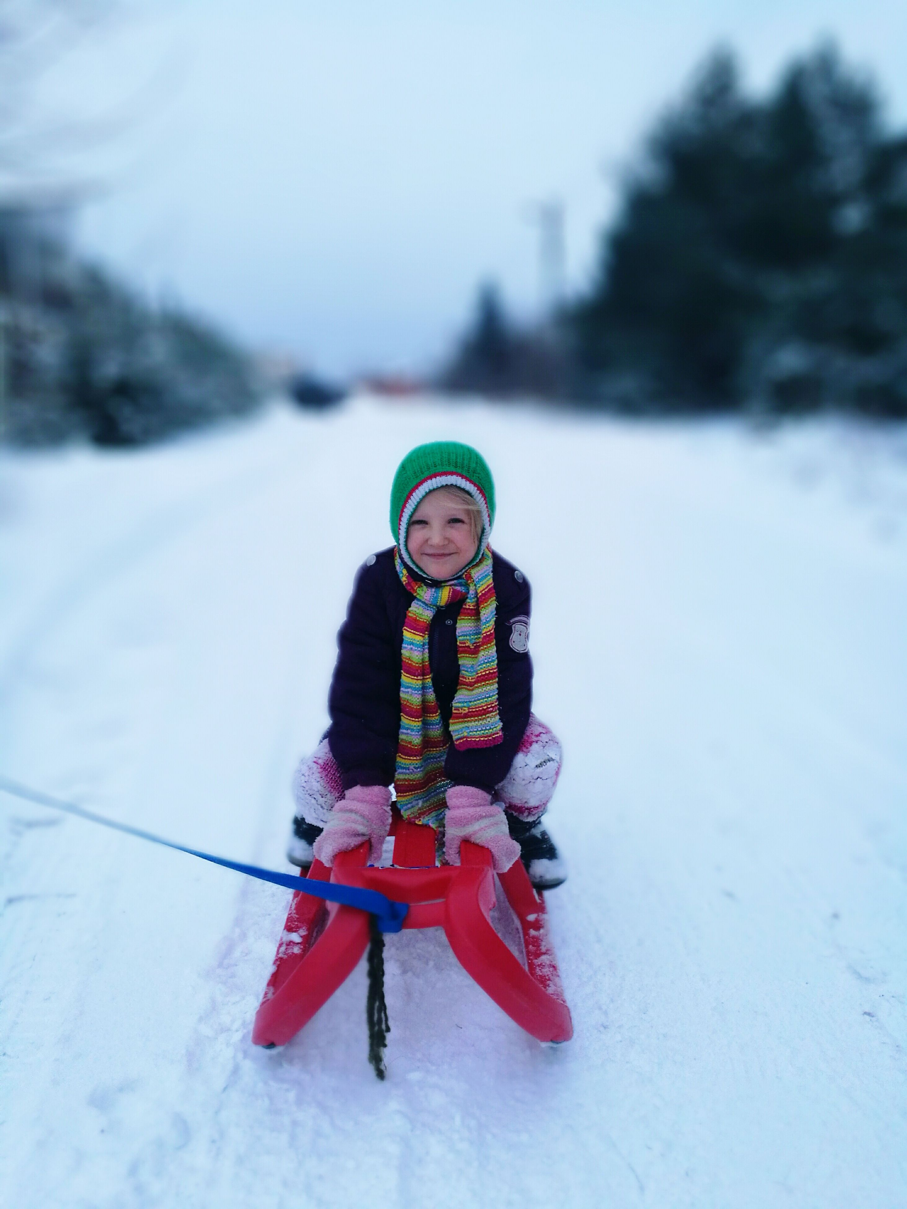 winter, snow, child, warm clothing, cold temperature, one person, ski-wear, childhood, children only, people, ski holiday, ski goggles, sled, playing, knit hat, outdoors, winter sport, one girl only, sport, tobogganing, vacations, happiness, snowboarding, day, mountain, ski jacket, young adult, nature, headwear, adult