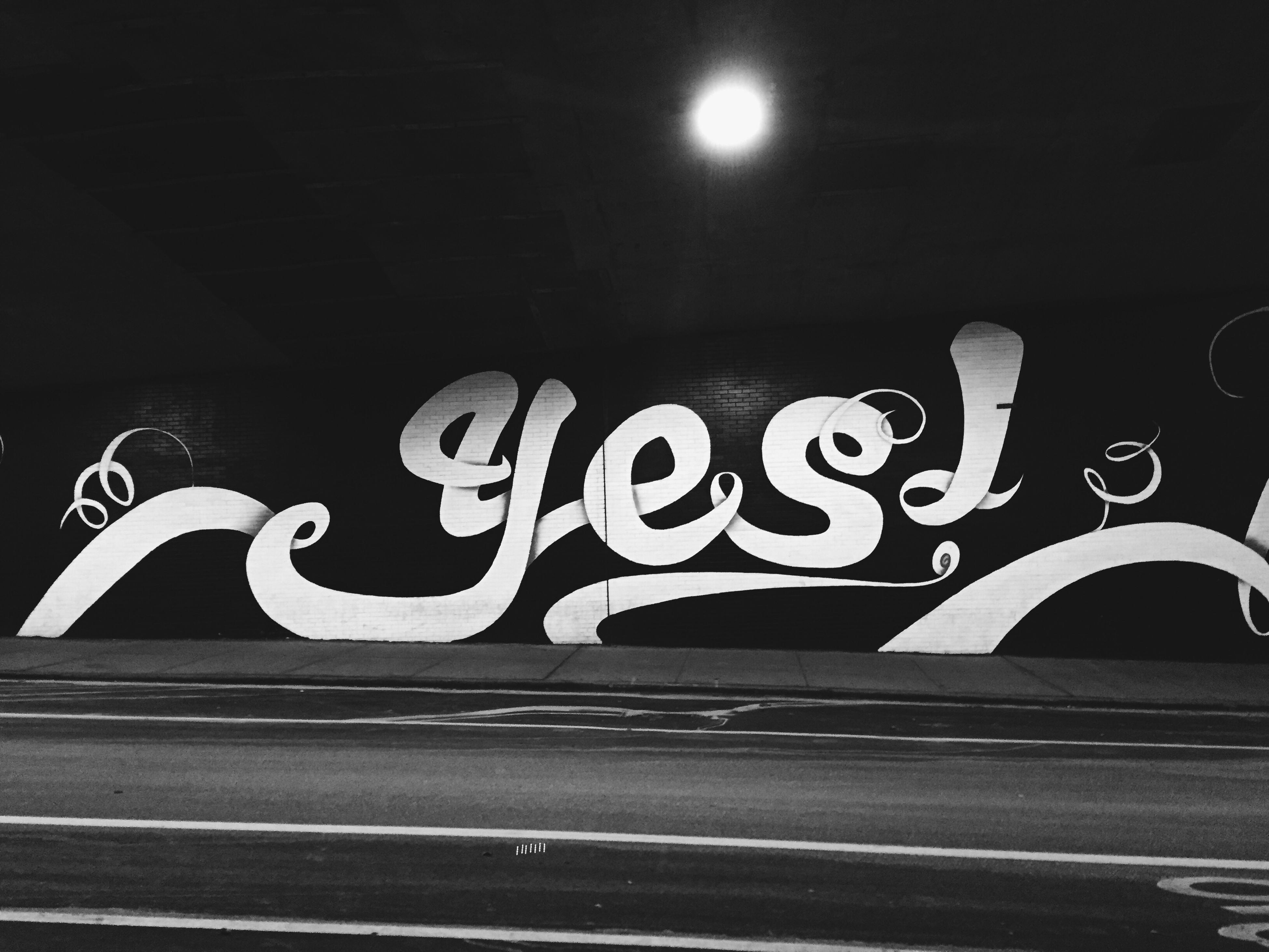 text, western script, illuminated, communication, graffiti, sign, road marking, night, capital letter, transportation, information sign, wall - building feature, street, built structure, road, guidance, arrow symbol, the way forward, architecture, information