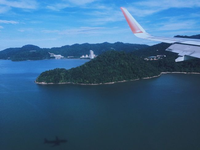 The wing, the island and the silhouette- hyperbeast Vscocam VSCO From An Airplane Window From My Point Of View Hello World Taking Photos Enjoying Life Life In Motion EyeEm Best Edits IPhoneography Showcase: November EyeEm Best Shots Window Eye4photography  EyeEmBestPics EyeEm Nature Lover