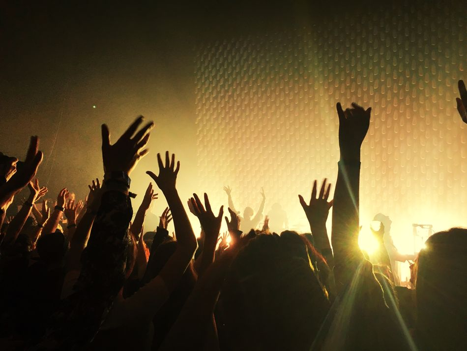 Large Group Of People Music Fun Crowd Arms Raised Enjoyment Excitement Audience Popular Music Concert Nightlife Stage Light Arts Culture And Entertainment Illuminated Youth Culture Real People Carefree Event Concert Concert Photography Put Your Hands Up