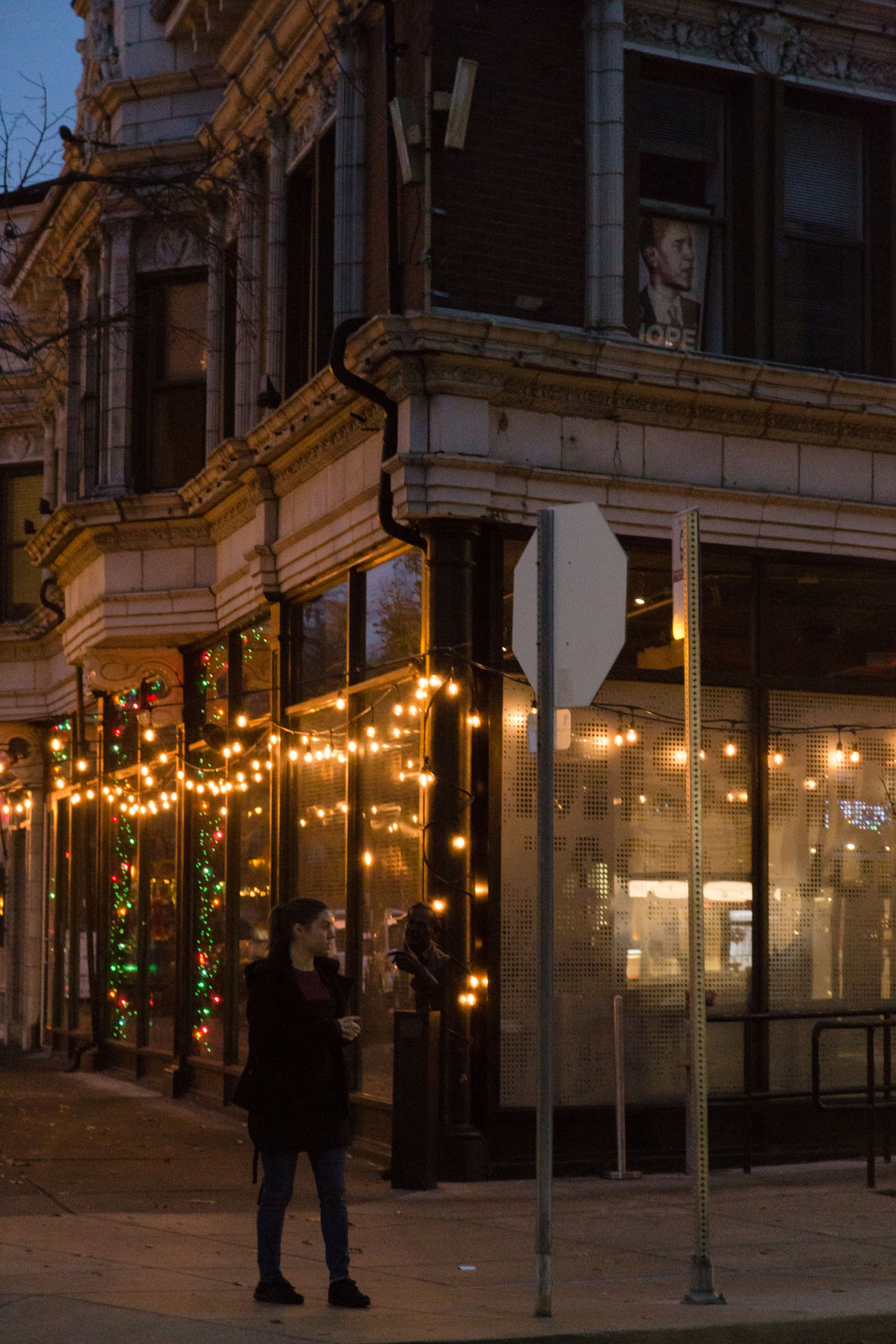A scene in St. Louis A Woman Adult Adults Only Architecture Christmas City City Corner Hope Illuminated Life In City Night Obama One Person Only Women Outdoors People Real People Standing Street Photography Urban Winter