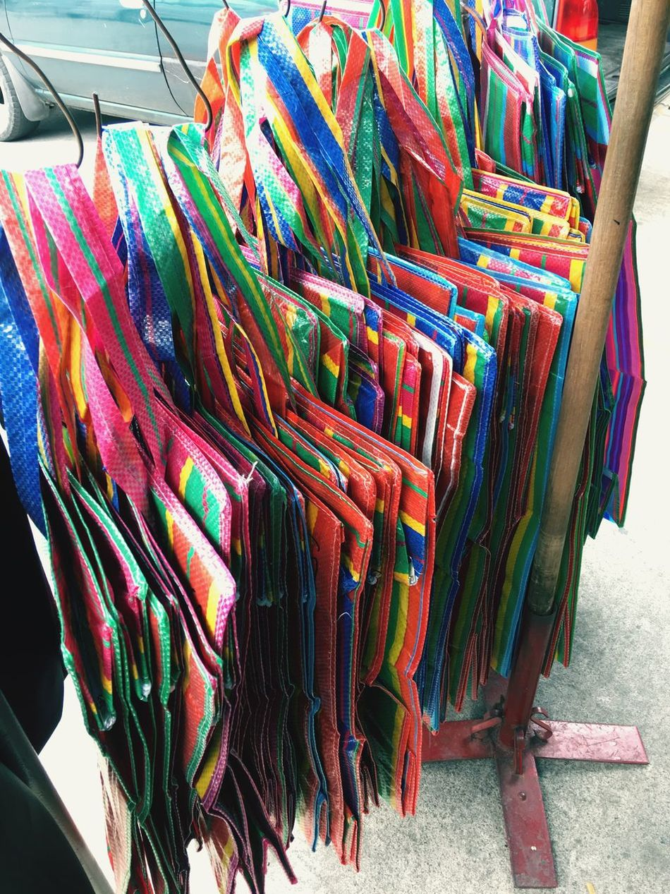 Multi Colored Variation Textile Choice Retail  Hanging Large Group Of Objects Collection Store Indoors  For Sale No People Close-up Day Pack Bag Balenciaga Bag Balenciaga กระเป๋าถุงสีรุ้ง