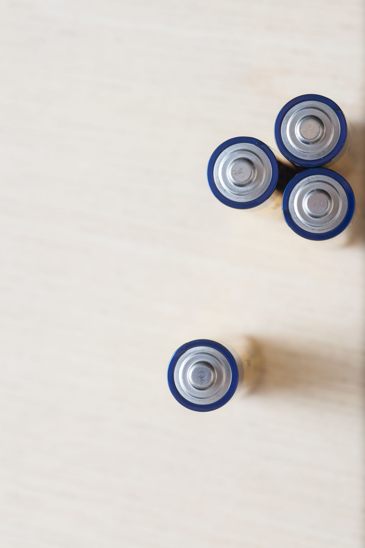 Batteries. A collection of alkaline batteries from above overhead view. Circles abstract pattern. Separate technology concept Abstract Aerial Shot Alkaline Background Batteries Battery Blue Circles Collection Electricity  Energy From Above  Future Lithium Muted Colors Natural Light New Talent This Week Old Pattern Power Stand Out From The Crowd Tech Technology Technology I Can't Live Without Top View