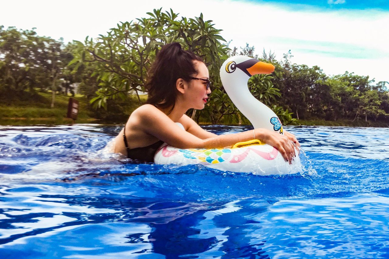 Swimming Pool Water Inflatable  Inflatable Ring One Person Floating On Water Summer Pool Raft Fun Holding Day Childhood One Girl Only People Children Only Outdoors Playing Vacations Child Swimming