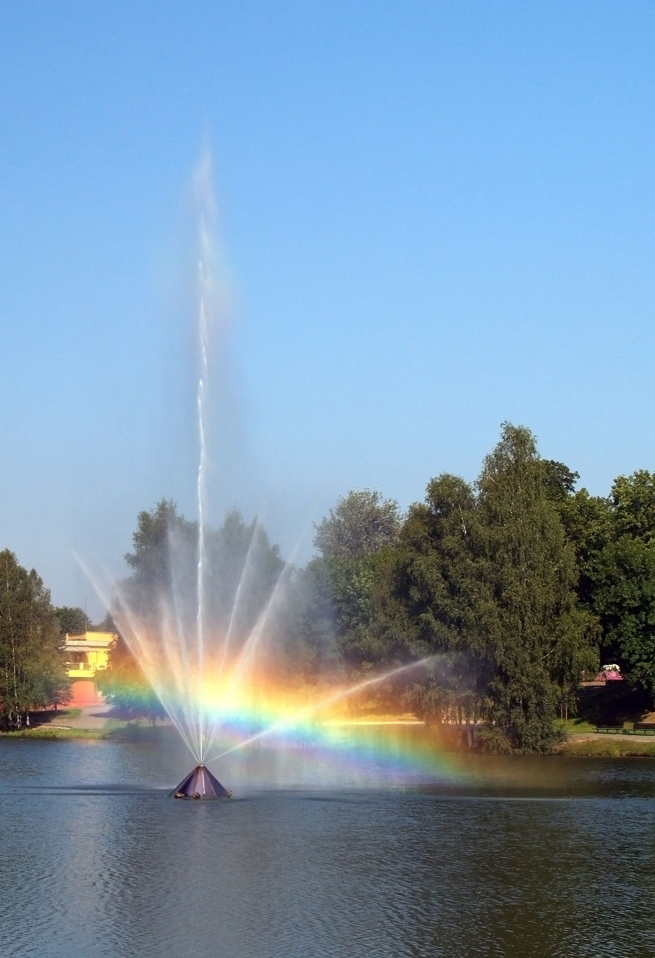 Fountain with rainbow in the small lake in resort town Druskininkai, Lithuania. Day Druskininkai Dancing Fontain Druskininkai Lithuania 🇱🇹 Fountain Fountain Rainbow Lake No People Outdoors Rainbow🌈 Sky Splashing Spraying Tree Water