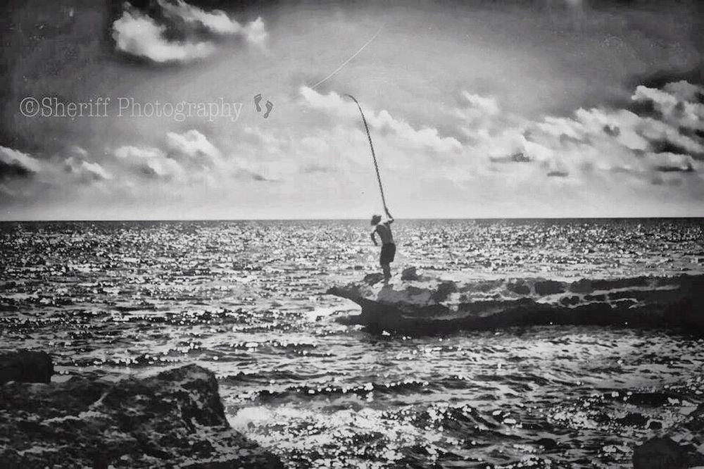 Tranquility Bw Shilloutte Horizon Over Water Tranquility Life Is A Beach BW Collection EyeEm Best Shots - Black + White My BW Obession Tadaa Community Beach My Bw Obsession My Unique Style Water Sea Fishing Rod Hobbies Scenics Fishing Waterfront Men Sky Rippled Tranquil Scene Holding Sailboat Vacations Nature Cloud - Sky Seascape Day