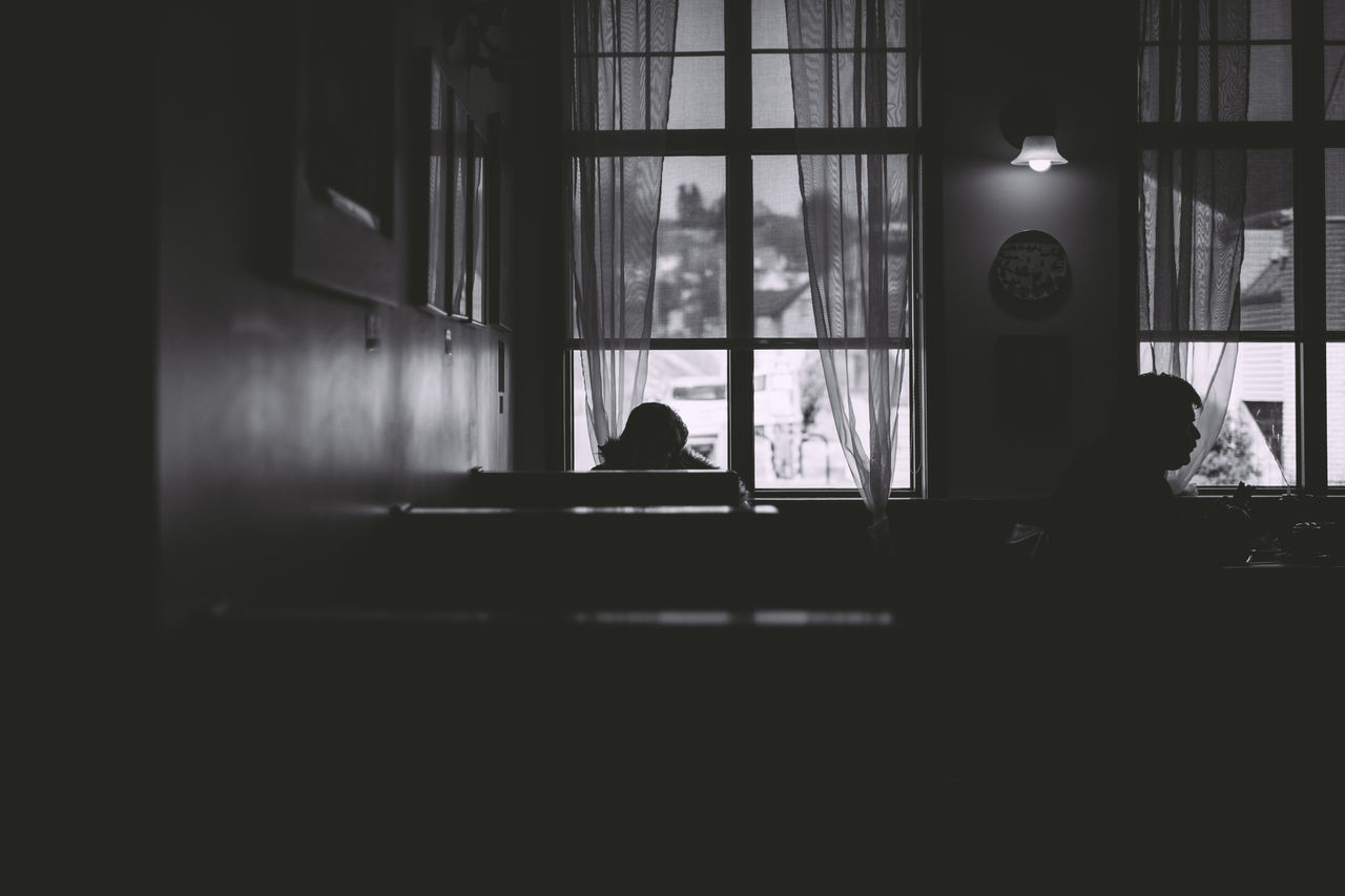 Black And White Day Indoors  One Person One Woman Only People Real People Restaurant Silhouette Window