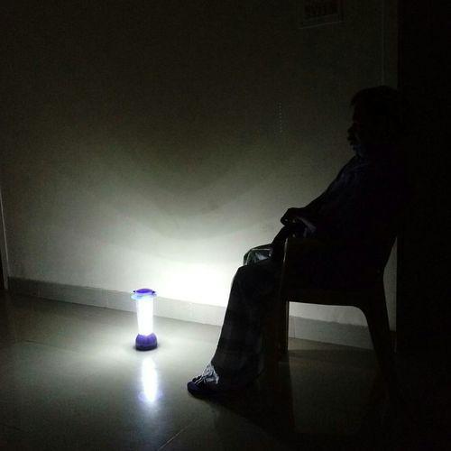 Man Sitting Sitting Latern Emergency Light Dark And Light Dark Room Nightphotography Night
