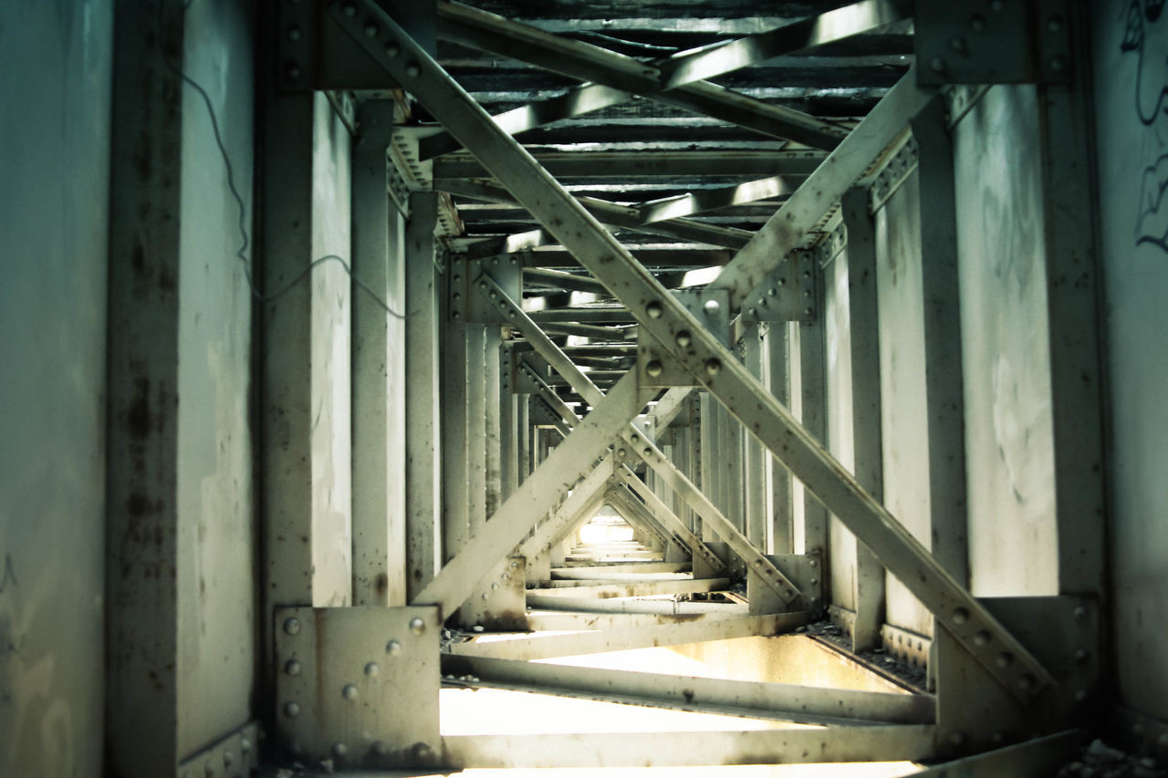 Architectural Column Architectural Detail Architecture Built Structure Criss Cross Day Different Perspective Diminishing Perspective Empty Engineering In A Row Interesting Intriguing Light And Dark Metal Metal Bars No People Repetition The Way Forward Tunnel Vanishing Point Wooden The Secret Spaces
