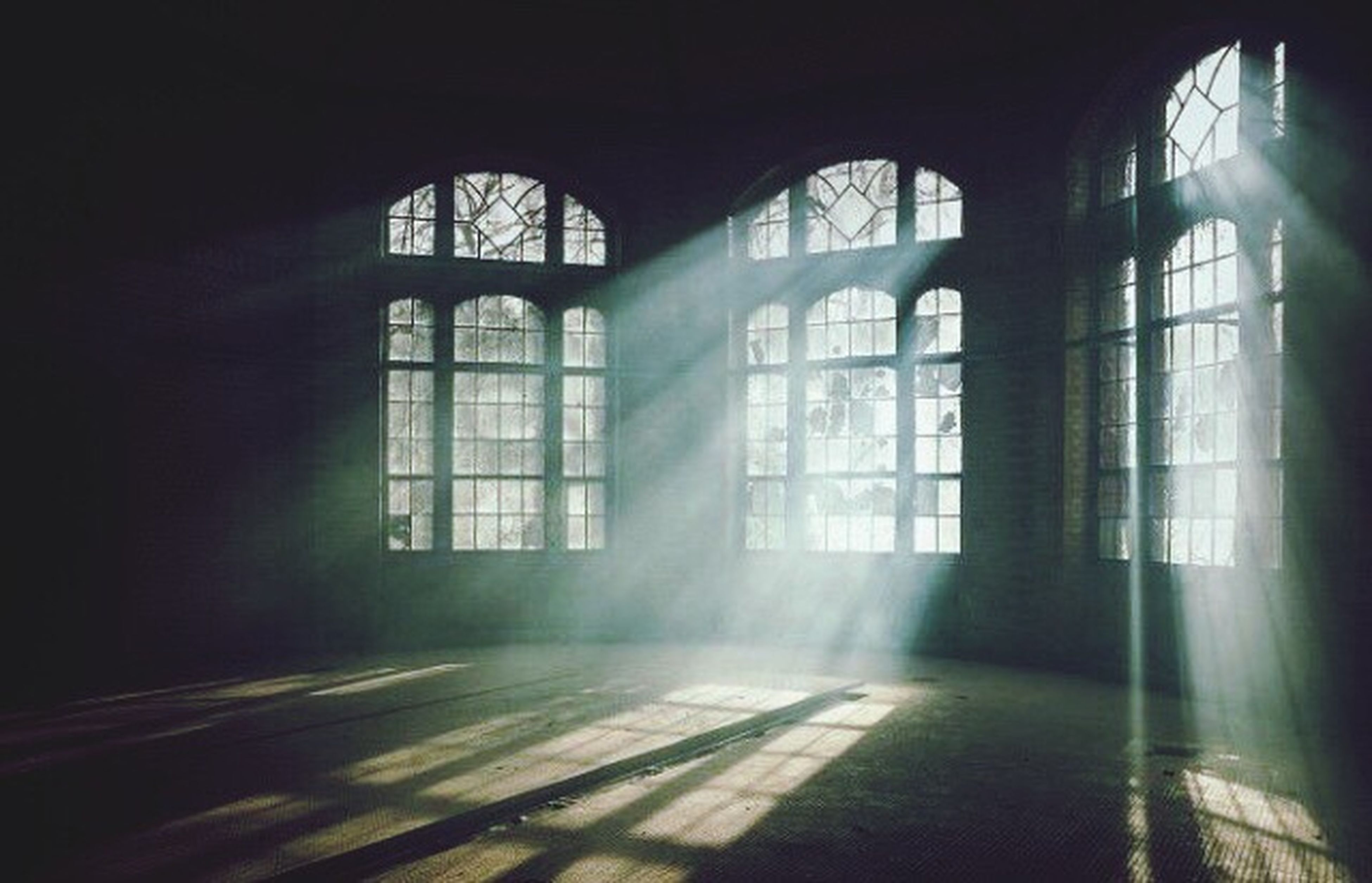 indoors, window, architecture, built structure, empty, arch, glass - material, sunlight, door, interior, the way forward, absence, corridor, no people, flooring, transparent, day, building, wall, ceiling