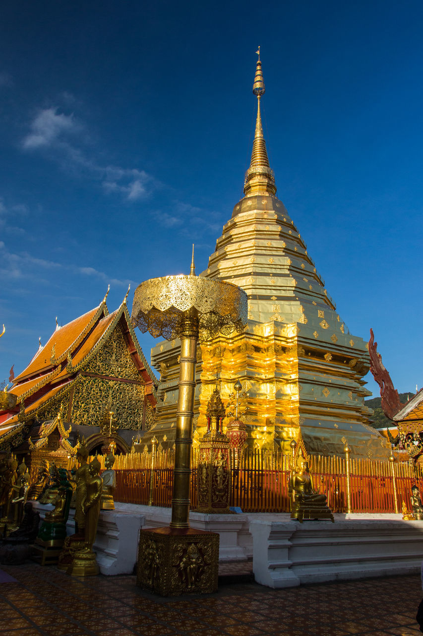 religion, spirituality, place of worship, gold colored, pagoda, sky, architecture, ancient, outdoors, travel destinations, statue, built structure, day, gold, building exterior, no people, nature